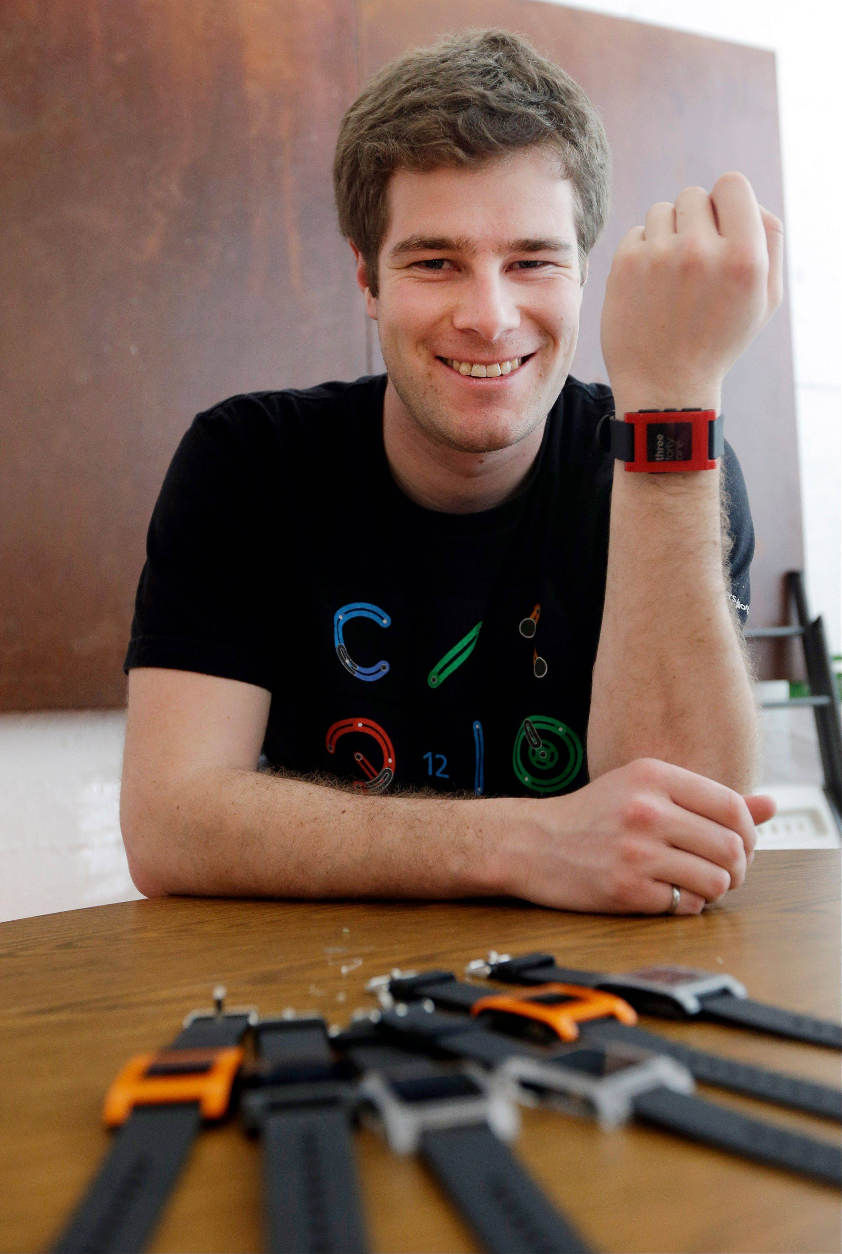 Eric Migicovsky, CEO of Pebble, displays his company's smart watch in Palo Alto, Calif. This new watch not only tells time, but also connects to smart phones within 10 meters.