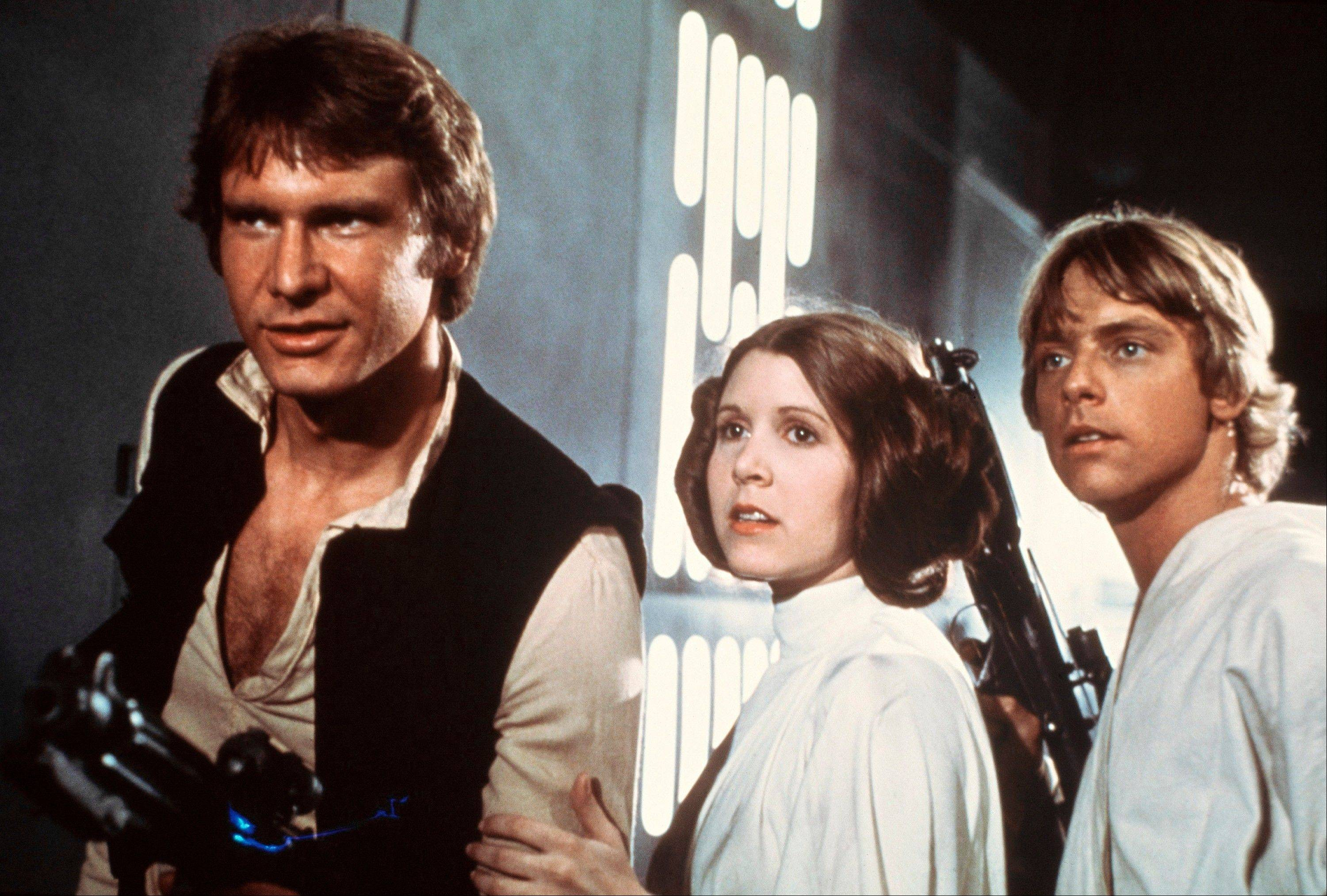 "Harrison Ford, as Han Solo, Carrie Fisher, as Princess Leia Organa and Mark Hamill, as Luke Skywalker in a scene from the 1977 ""Star Wars"" movie."