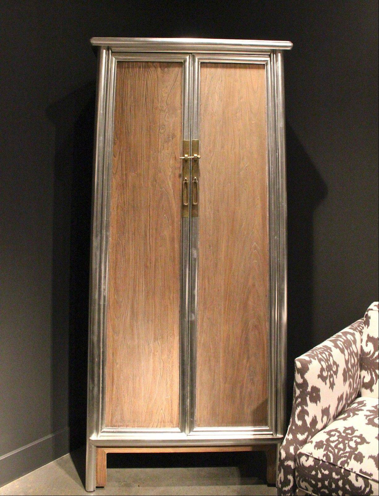 Brownstone's silver leaf and reclaimed elm wood Regency Cabinet with silver leaf trim.