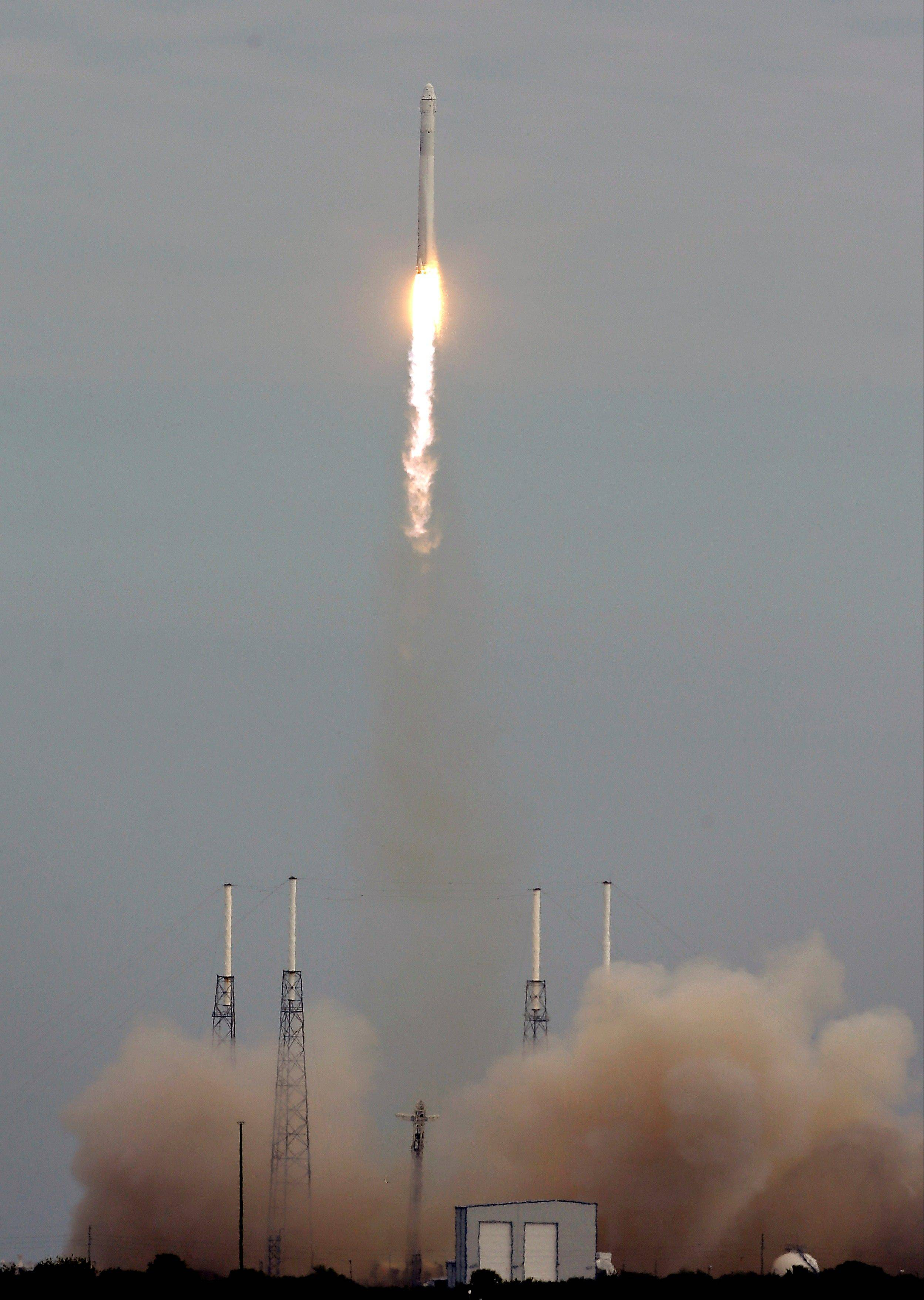 The unmanned Falcon 9 SpaceX rocket lifts off Friday from launch complex 40 at the Cape Canaveral Air Force Station in Cape Canaveral, Fla.