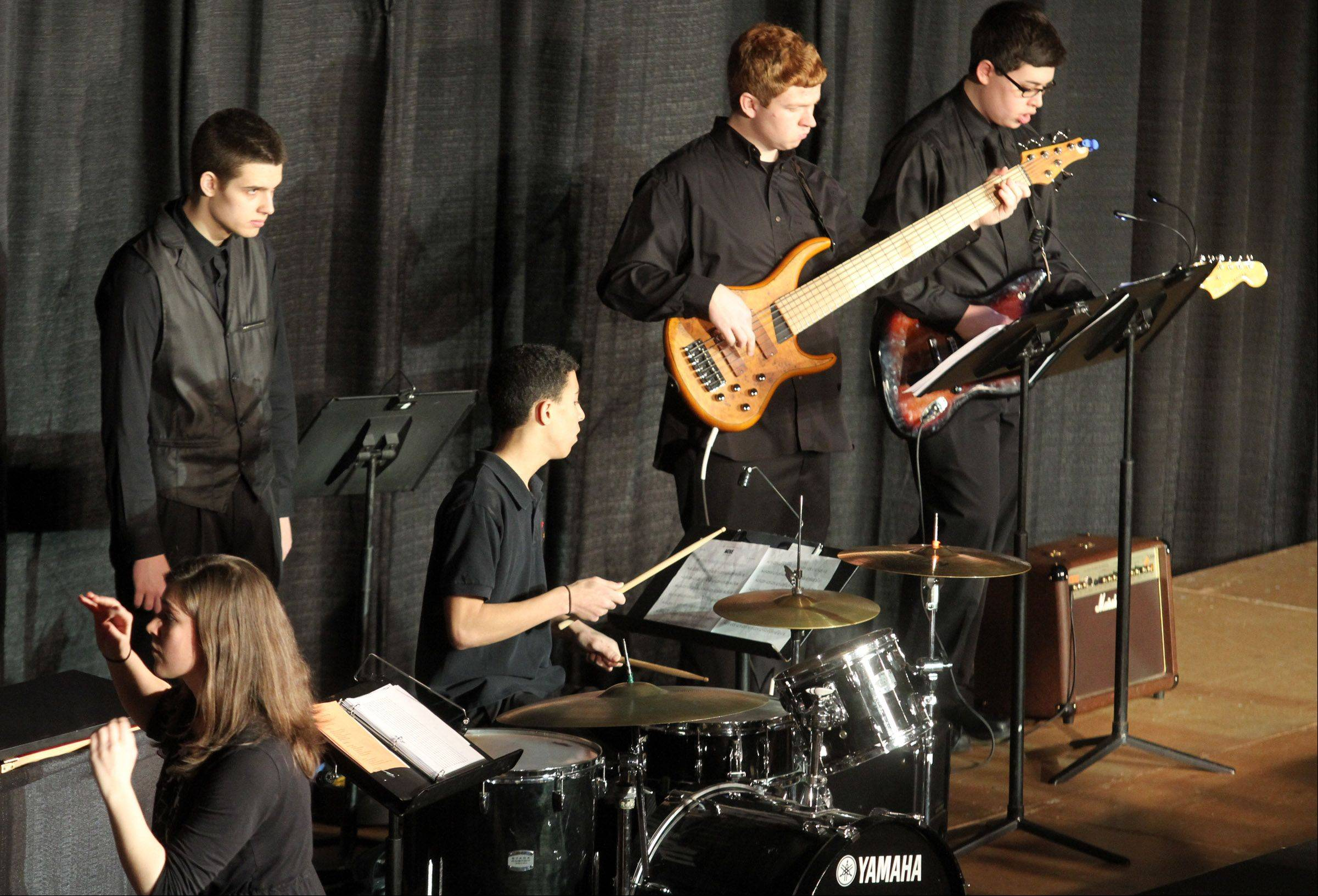 The band plays music for Leading Ladies of Rolling Meadows High School performs at the 20th annual Chicagoland Showcase hosted by Hersey High School in Arlington Heights on Saturday.
