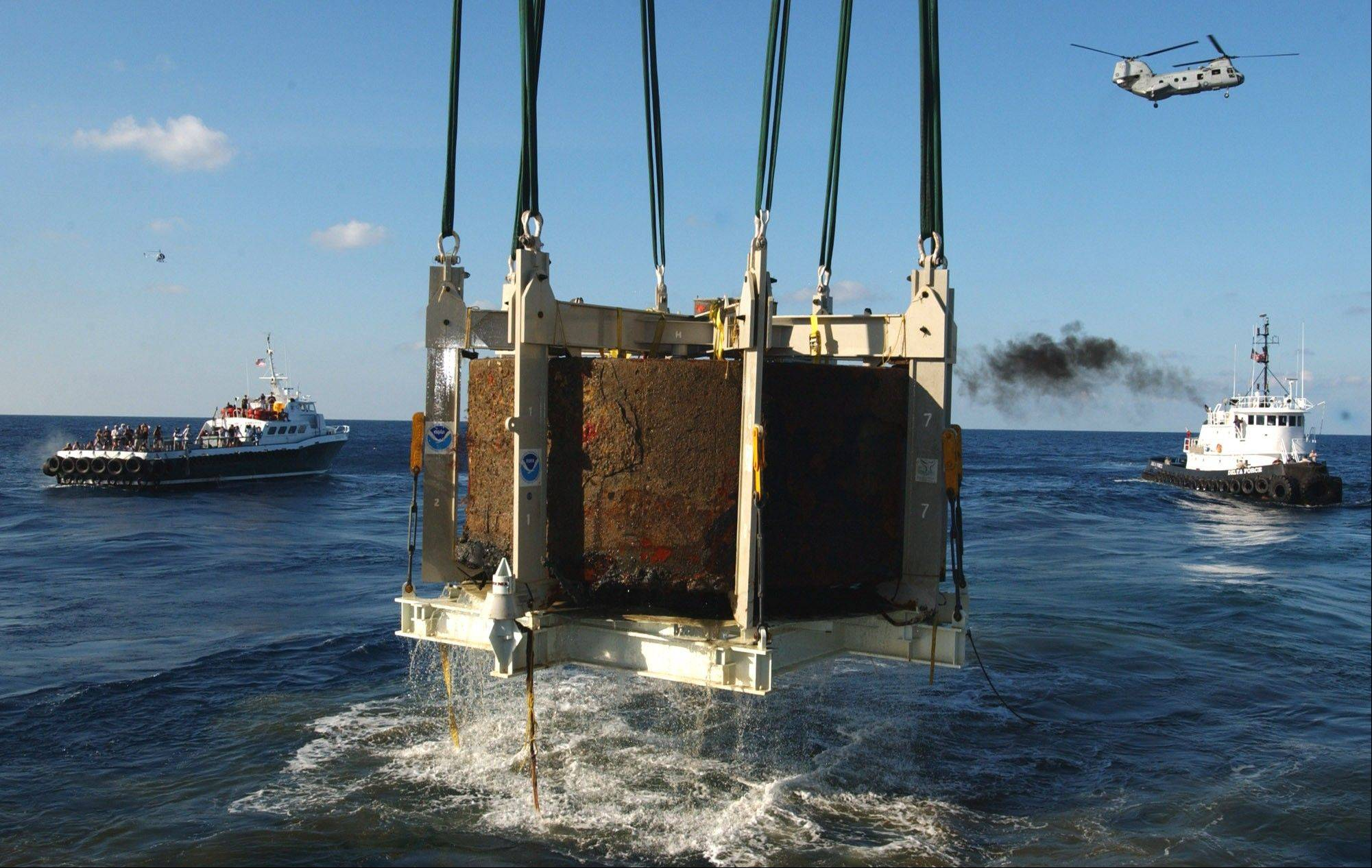 The turret of the Civil War ironclad USS Monitor is lifted out of the ocean off the coast of Hatteras N.C.