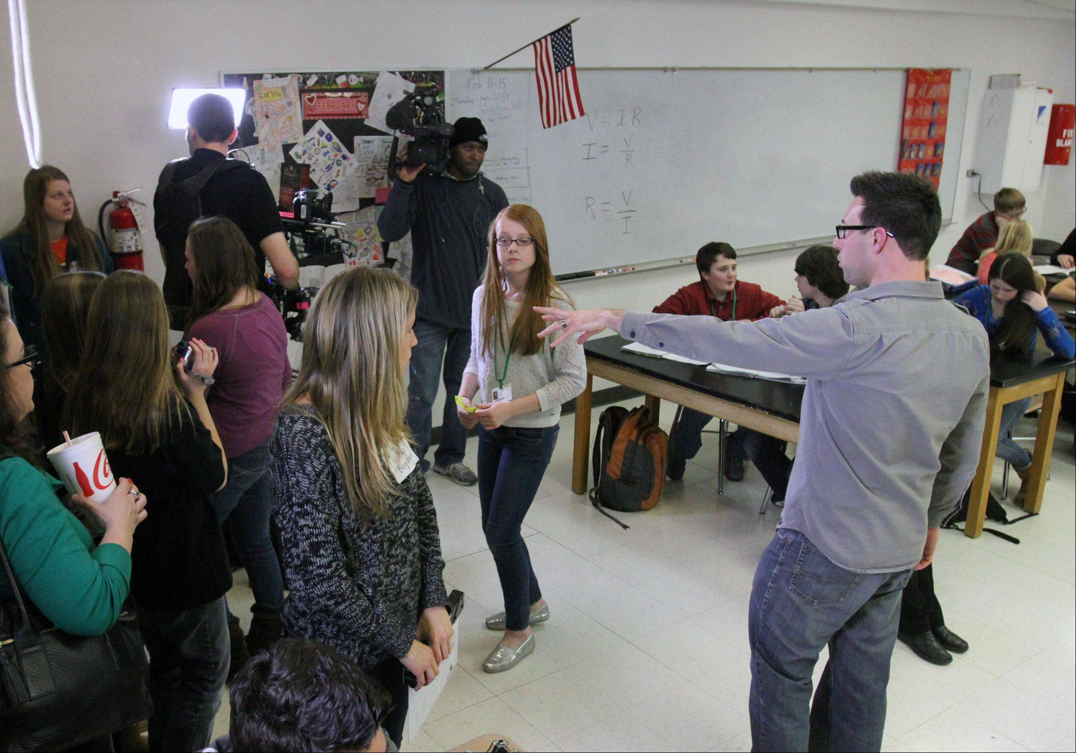 Columbia College television instructor Matt Till directs Morgan Niesen, left, and Riley Doyle, both seventh-graders at Woodland Middle School in Gurnee, while they acted in a video produced there Feb. 15. Gurnee police will use the video to help school employees who were hired in the middle of an academic year and didn't receive lockdown training.