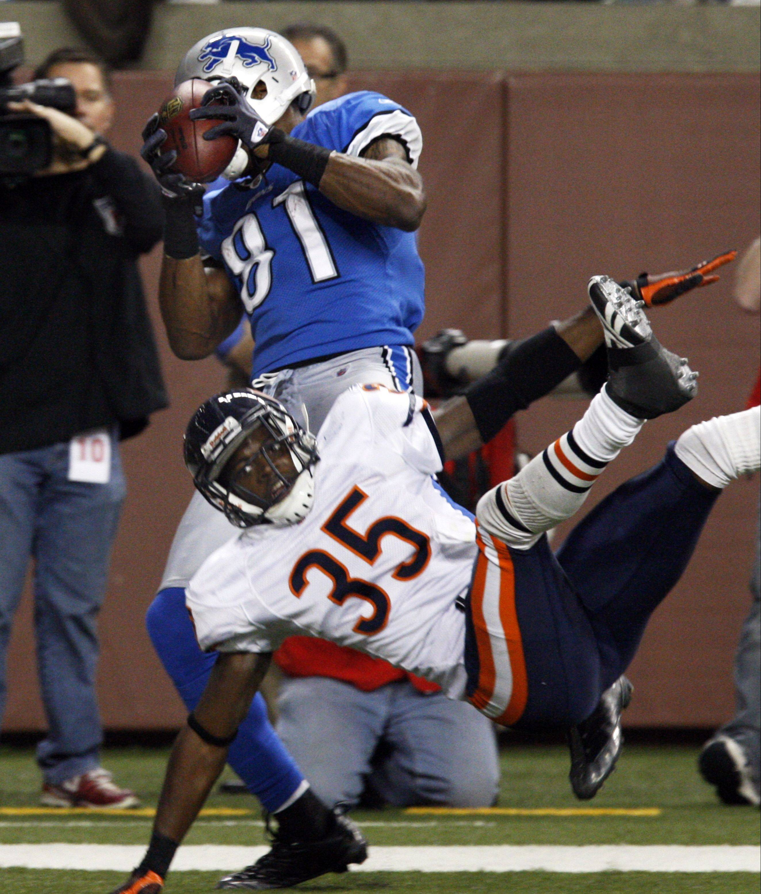 Calvin Johnson pulls down a touchdown while being defended by Zack Bowman on Jan. 3, 2010. Bowman is one of 18 unrestricted free agents the Bears must make a decision on in the coming days.