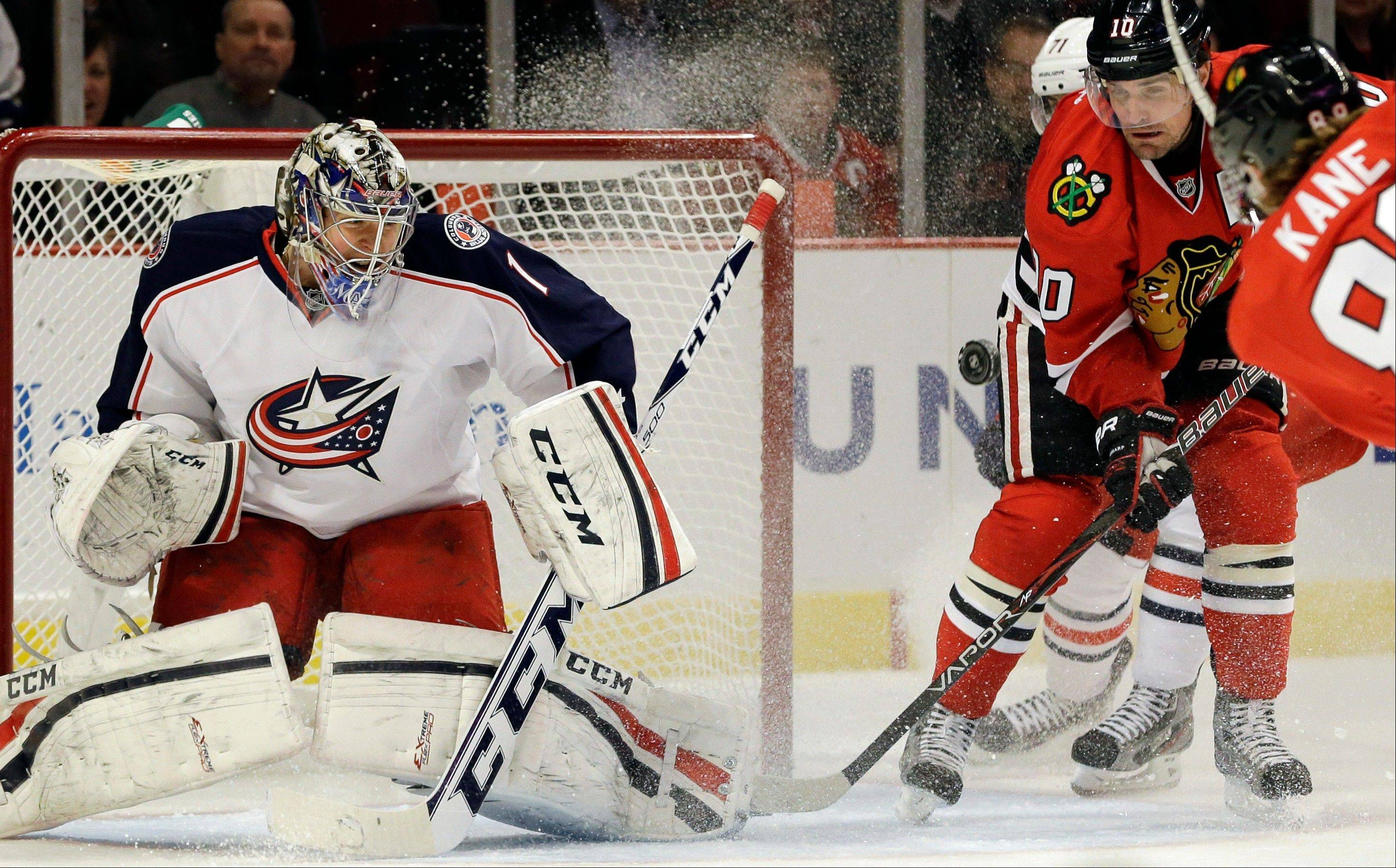 Columbus Blue Jackets goalie Steve Mason blocks a shot by Chicago Blackhawks' Patrick Kane during the second period .