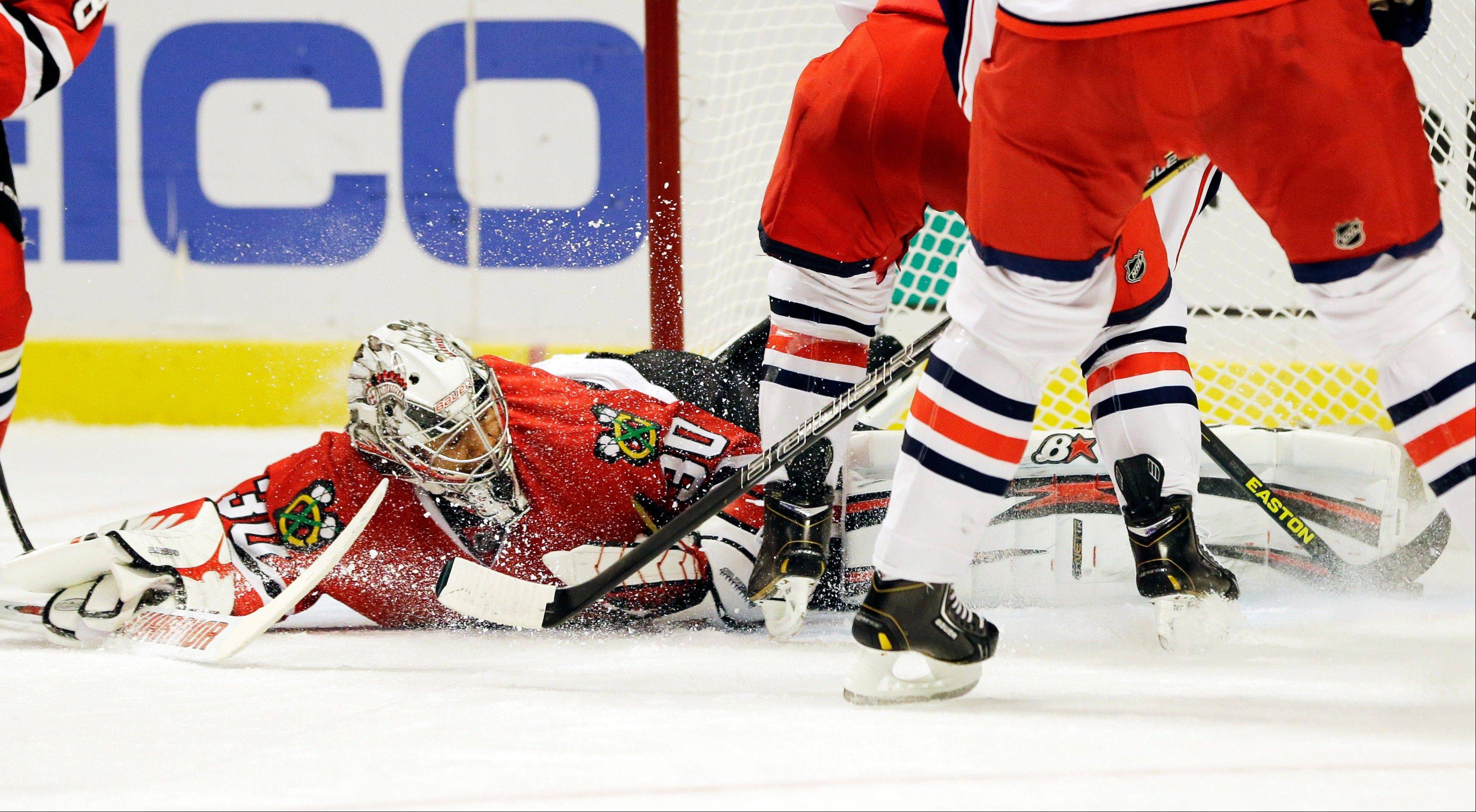 Chicago Blackhawks goalie Ray Emery blocks a shot by Columbus Blue Jackets' Cam Atkinson during the first period.