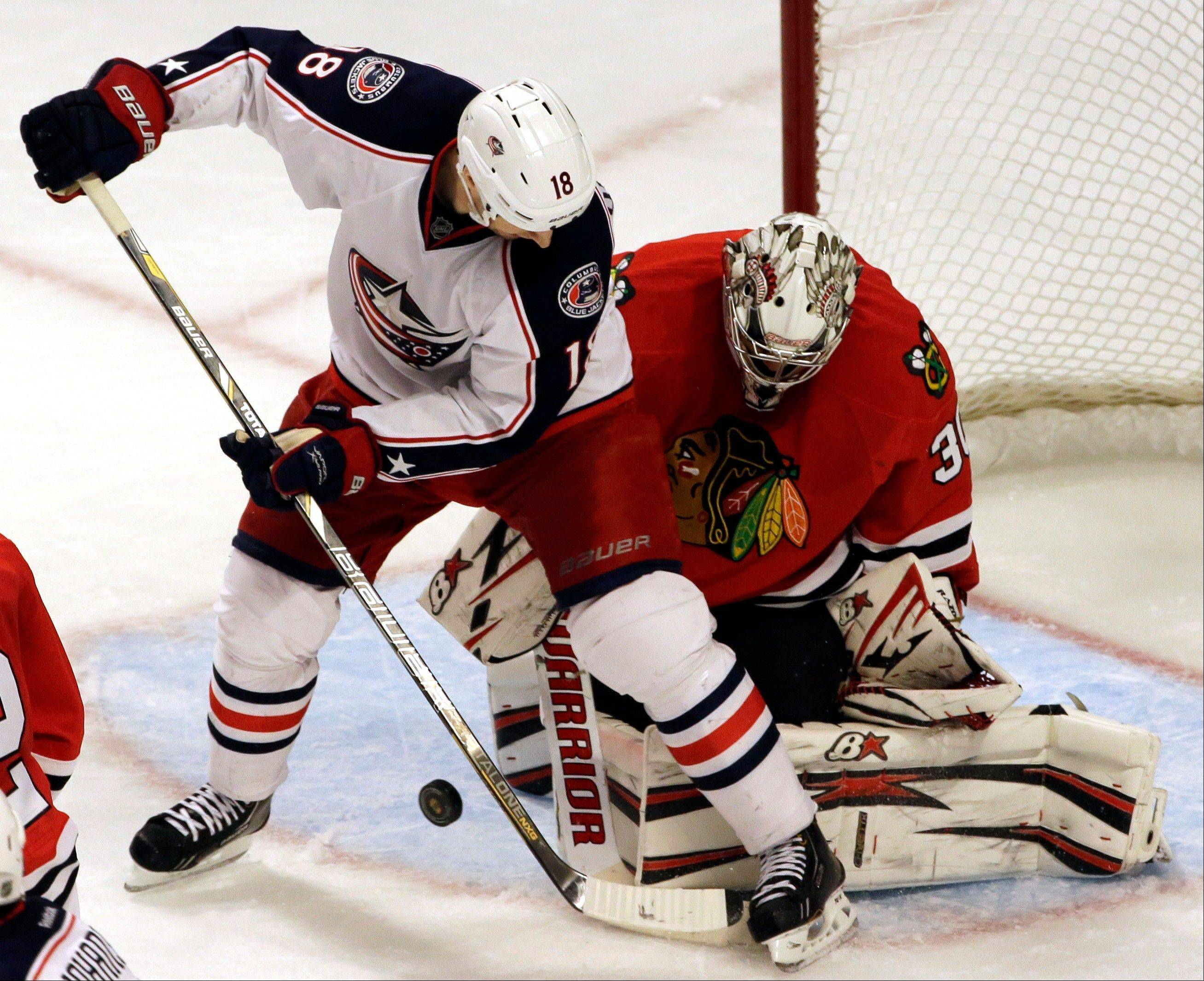 Chicago Blackhawks goalie Ray Emery, right, blocks a shot by Columbus Blue Jackets' RJ Umberger during the third period.