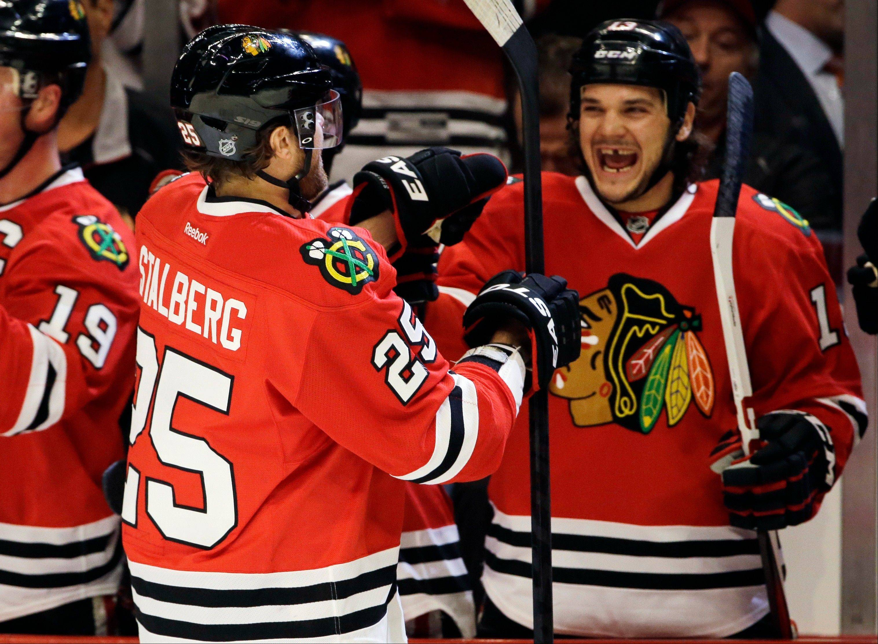 Chicago Blackhawks' Viktor Stalberg celebrates with teammates after scoring.