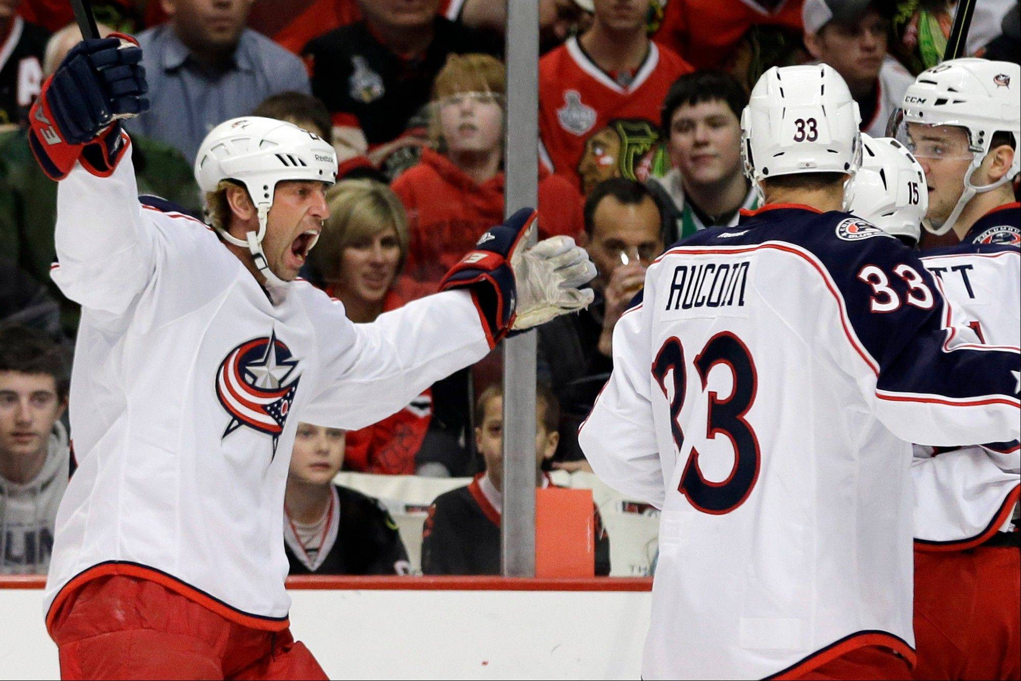 Columbus Blue Jackets' Vinny Prospal, left, celebrates with teammates after scoring against the Chicago Blackhawks during the first period.