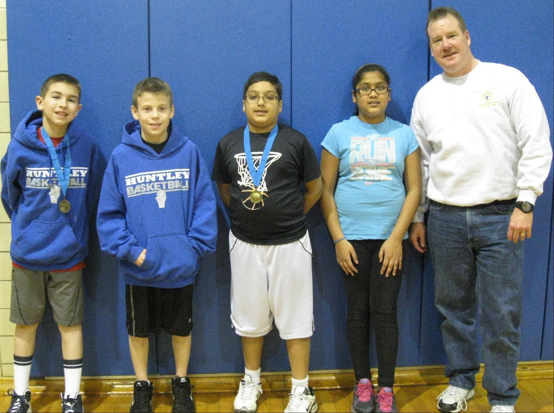 Zach Kriegler, left, Ryan Vrught, Ayush Agarwal and Radhika Agarwal, with Knight Jerry O'Sullivan, from the St. Mary of Huntley Knights of Columbus Council's Free Throw Championship attend the district competition held at St. Margaret Mary School on Feb. 16.