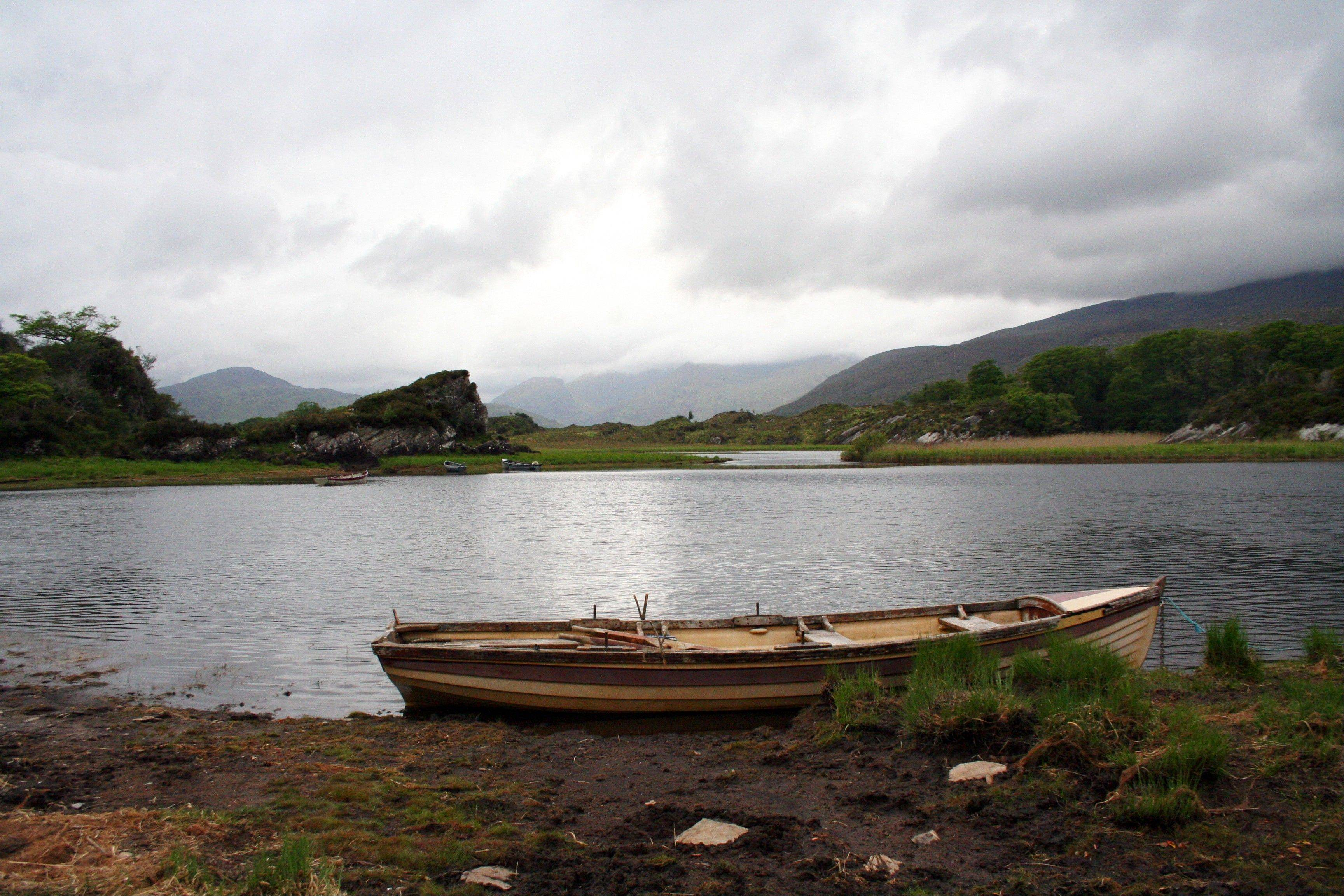Muckross Lake in Killarney National Park, County Kerry, Ireland. Ireland is about 300 miles from north to south and a driving trip in the country's western region takes you along hilly, narrow roads with spectacular views ranging from seaside cliffs to verdant farmland.