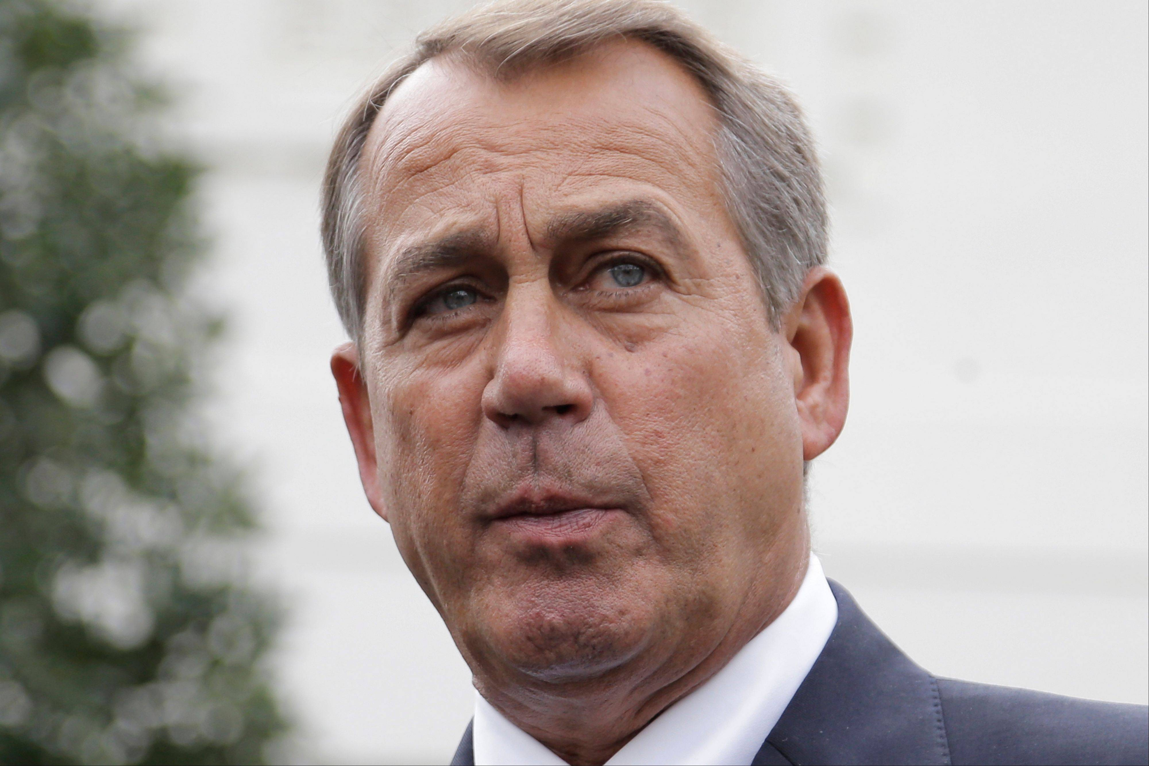 House Speaker John Boehner of Ohio speaks to reporters outside the White House in Washington, Friday, following a meeting with President Barack Obama and Congressional leaders regarding the automatic spending cuts.