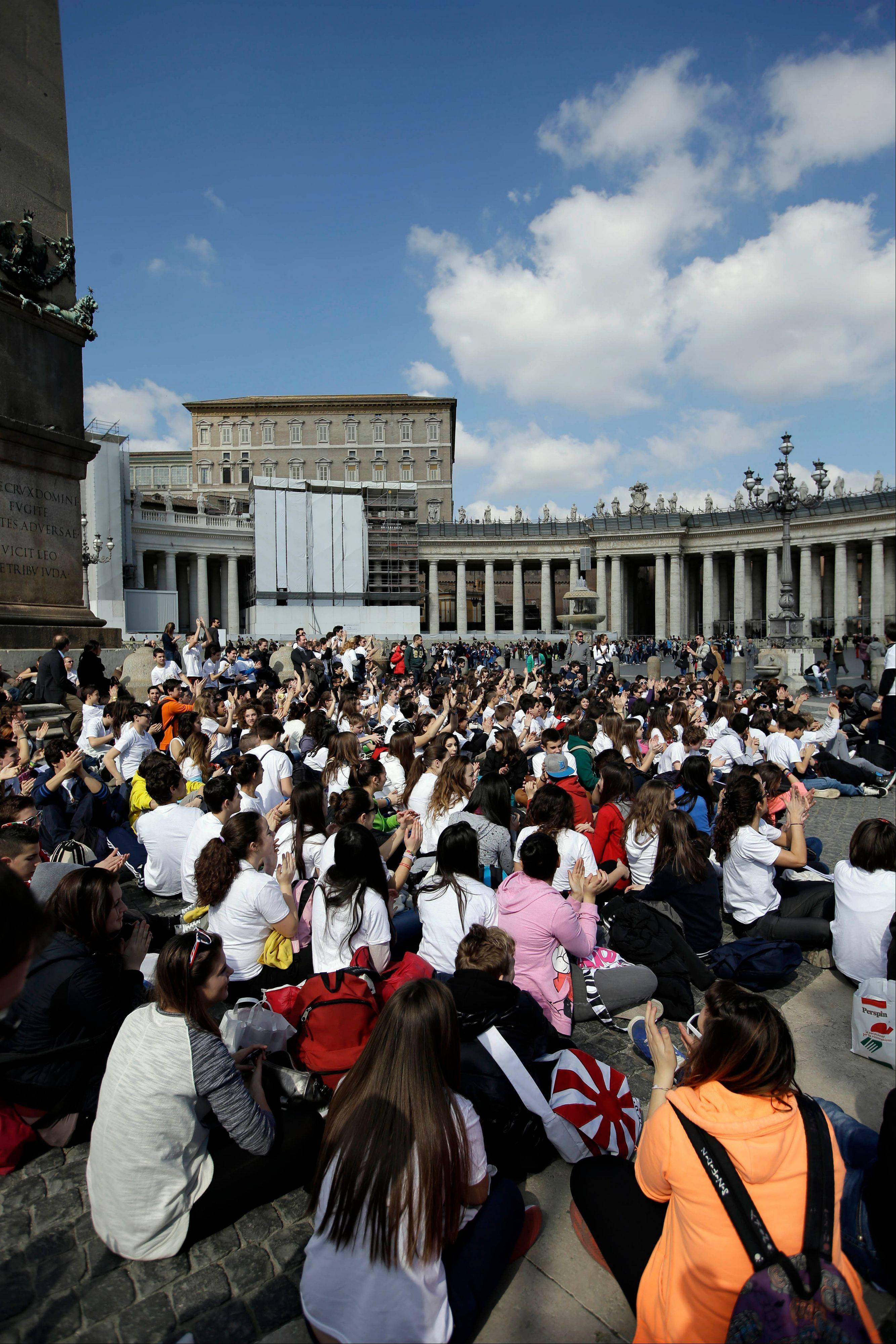 Youths celebrate an Angelus prayer in St. Peter�s Square at the Vatican Sunday. Benedict XVI�s opened what is known as the �sede vacante� or �vacant see,� the transition period between papacies when a few key Vatican officials take charge of running the church.