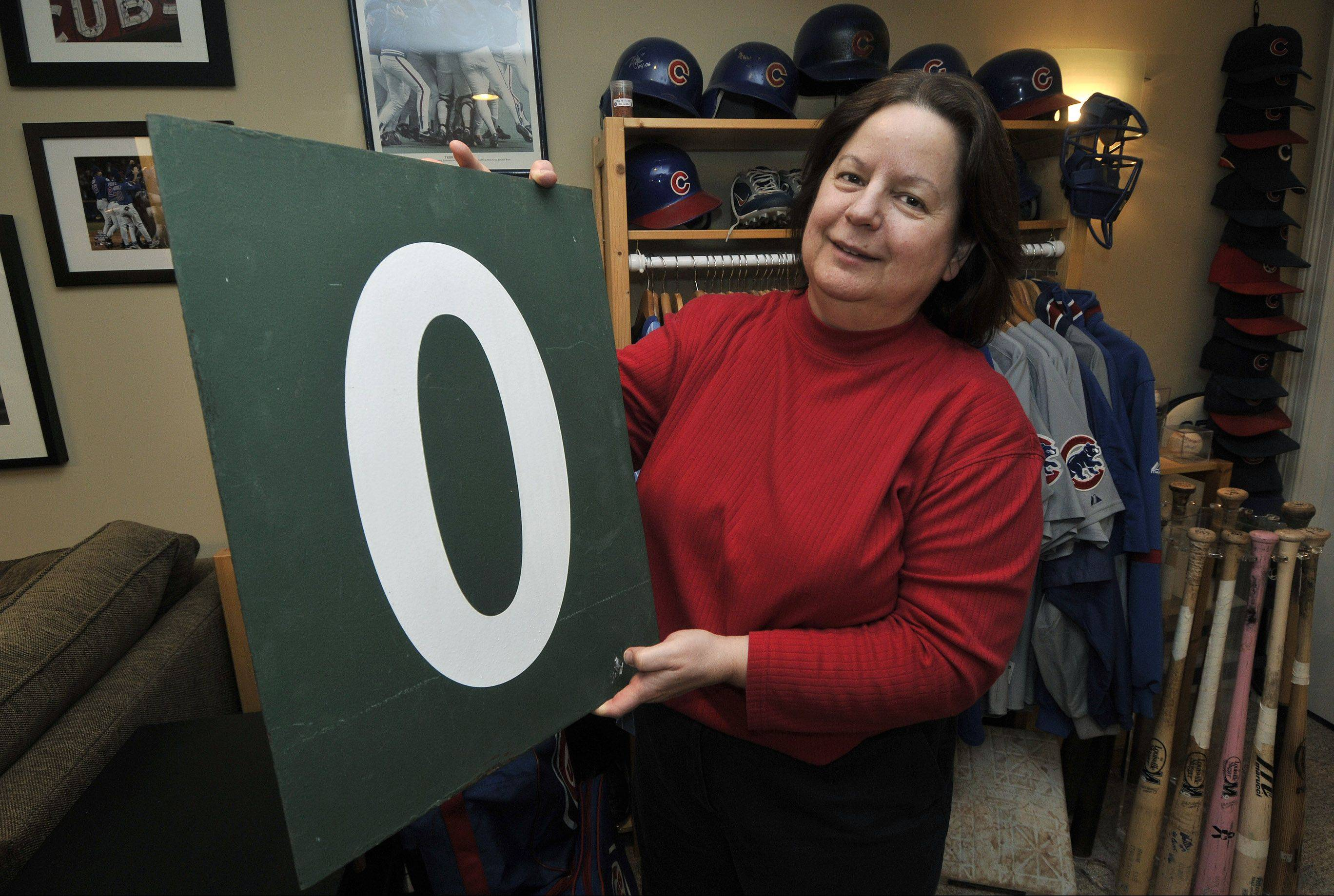 "After years of searching for her ""Holy Grail,"" longtime Cubs fan Sue Kren offered the winning bid for this zero from the historic Wrigley Field scoreboard."