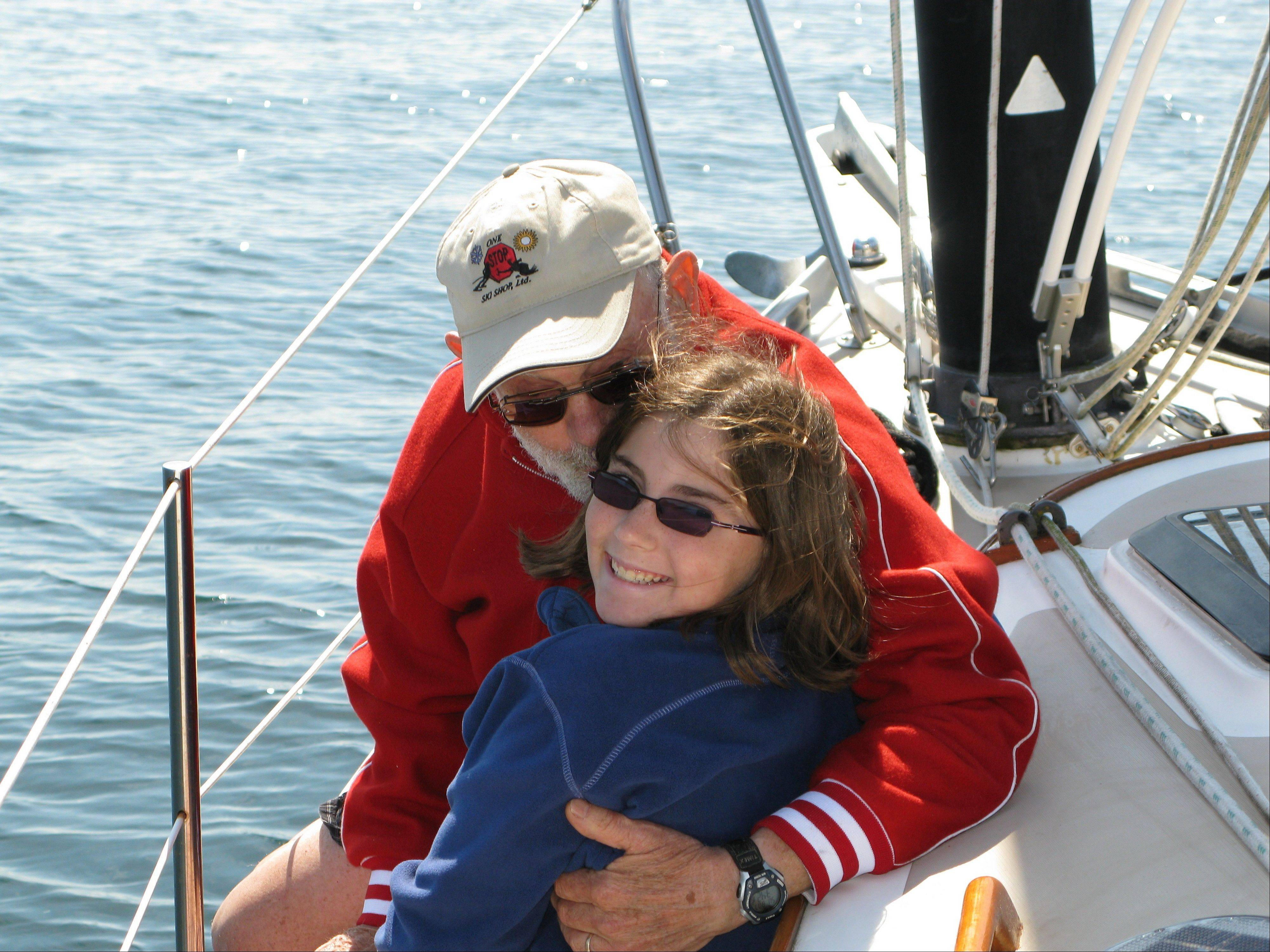 Nina Shelanski, 11, and her grandfather, Jerry Schwartz, enjoy a quiet moment during a family sailing trip in Blaine, Wash. Schwartz has cared for his granddaughter while her parents took a rare vacation without her, but it can be challenging for couples looking to get away without their children to line up help from relatives or sitters.