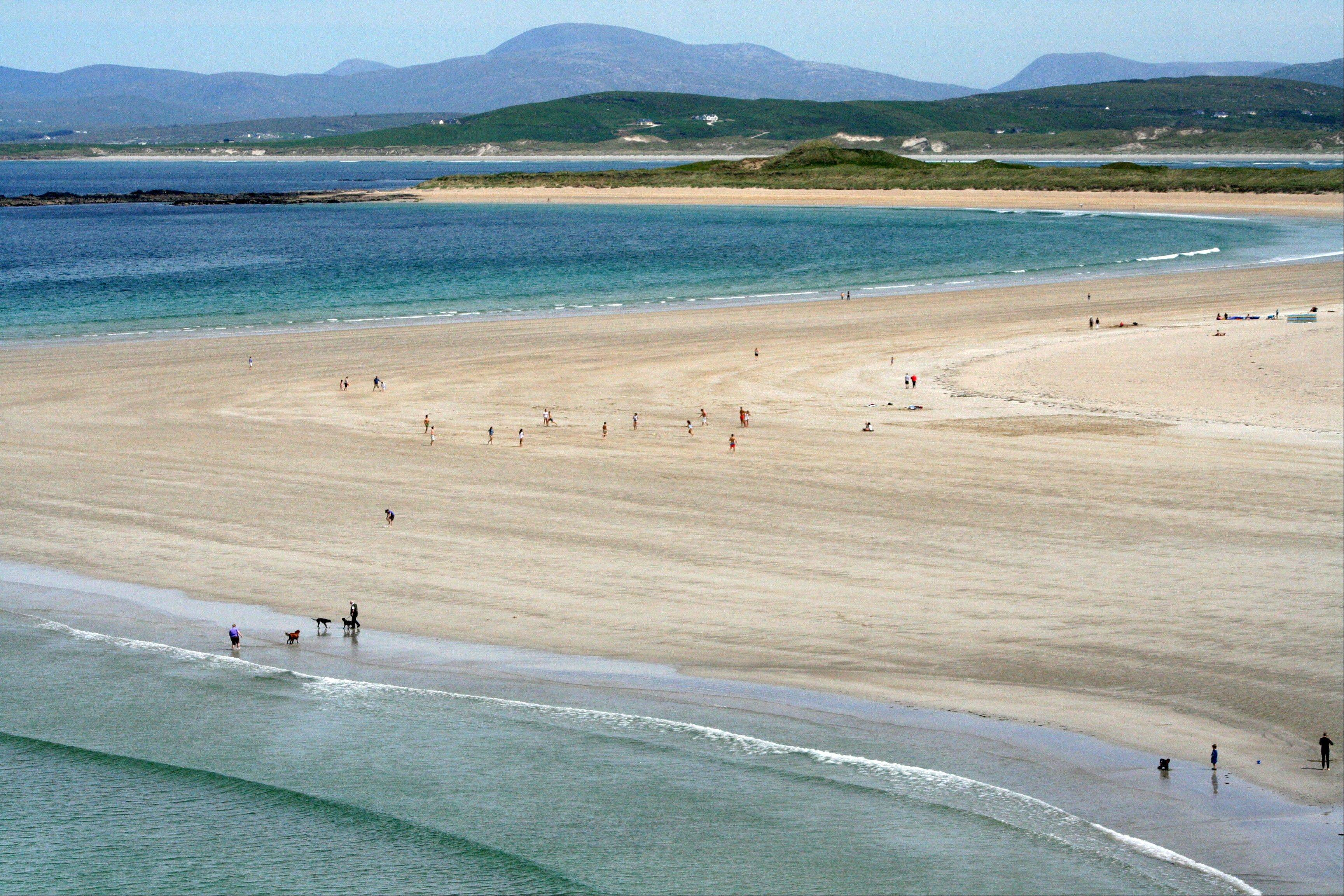 Swirls of sand, land and sea at the Portnoo Strand in County Donegal, Ireland.