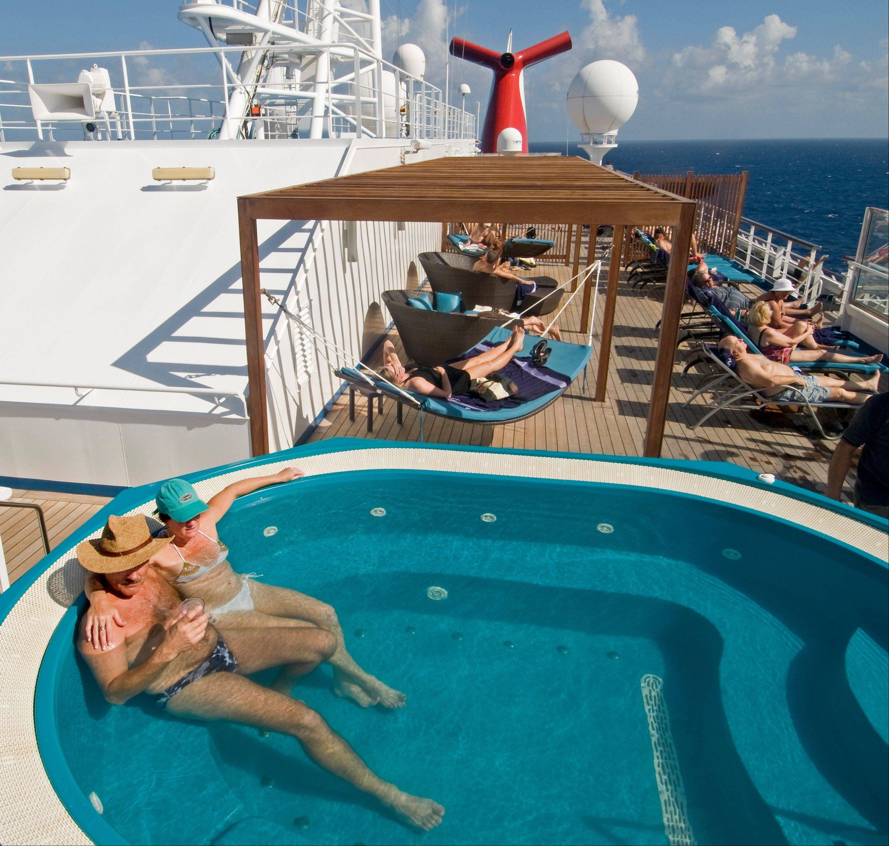 Guests relax in an adults-only areas aboard the Carnival Liberty.