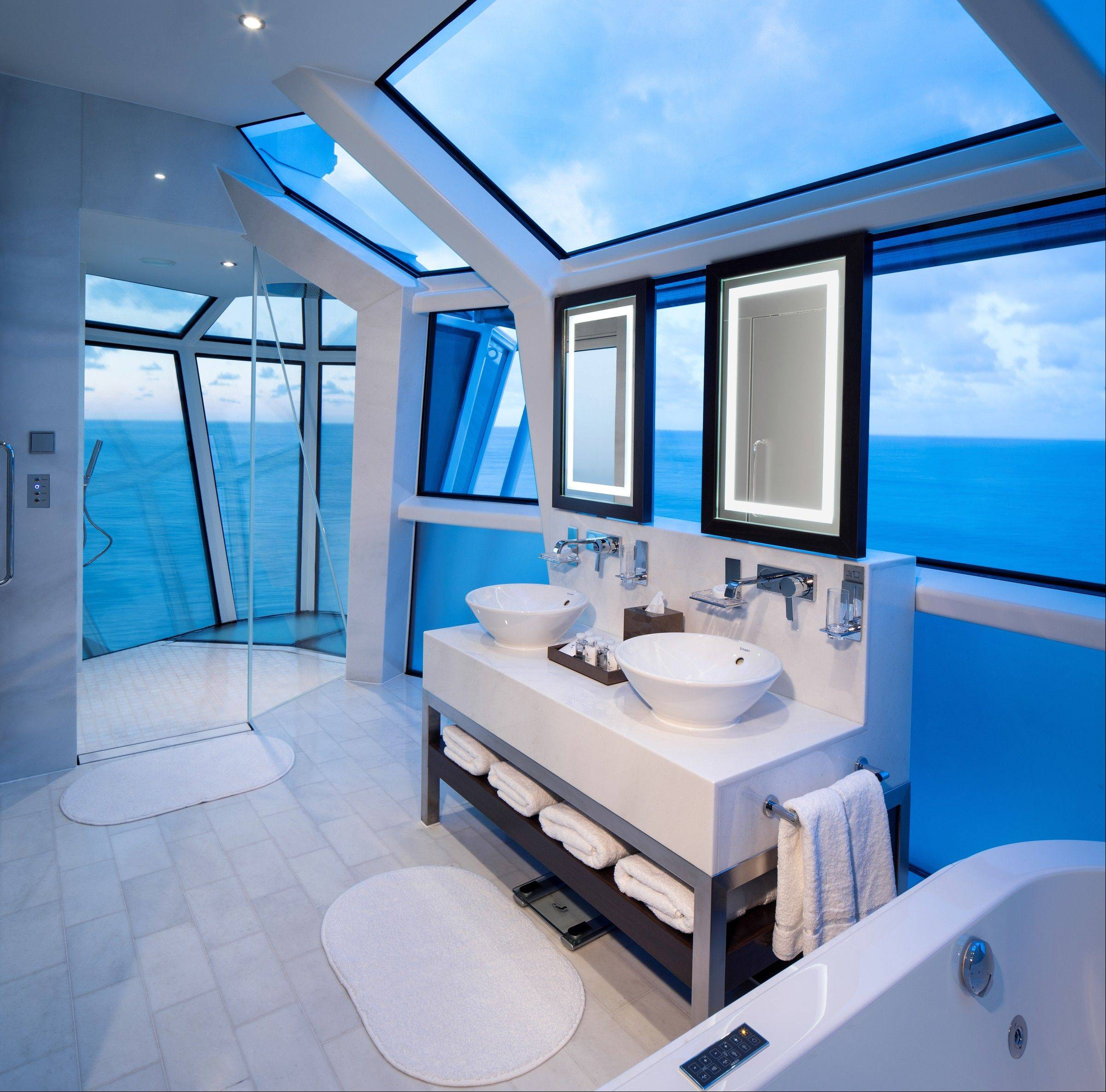 The Reflection Suite bathroom on Celebrity's new Reflection ship is an all-glass shower that extends over the edge of the ship with a wraparound veranda and special glass so you can see out, but not in.