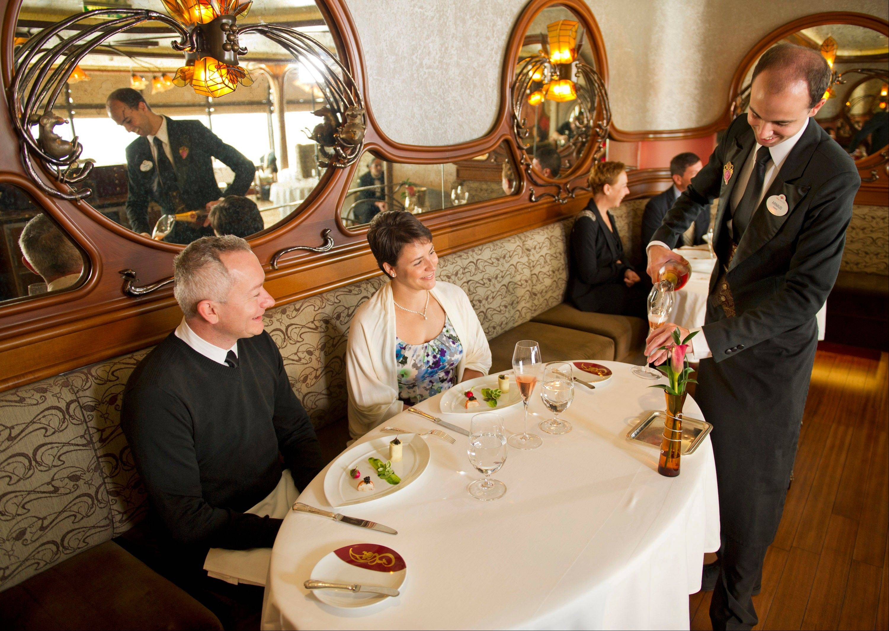 A couple enjoys a champagne brunch at Remy, the adults-only restaurant on Disney's Fantasy and Dream ships.