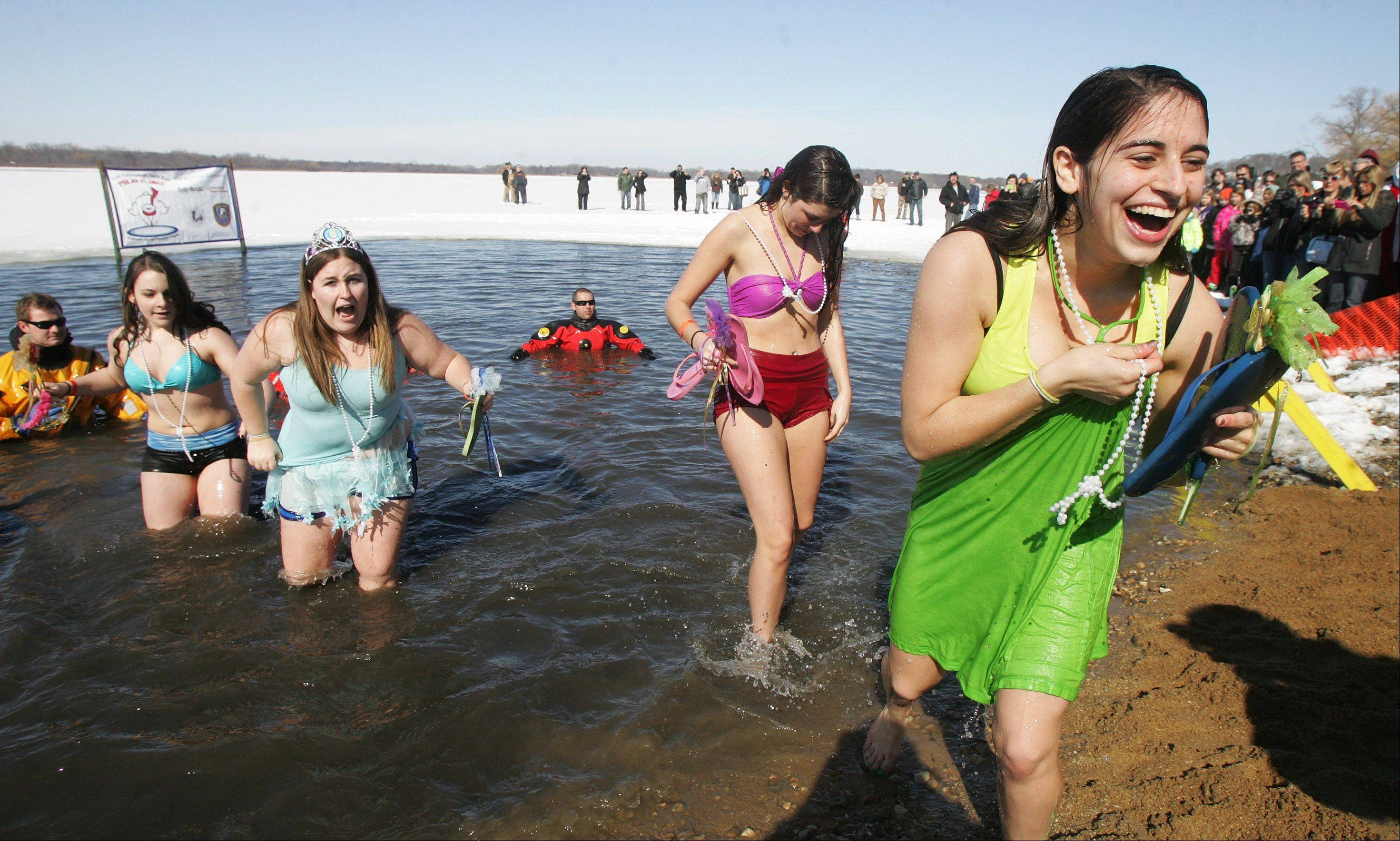 The Pajama Princesses leave the water during the annual Fox Lake Polar Plunge at Lake Front Park.