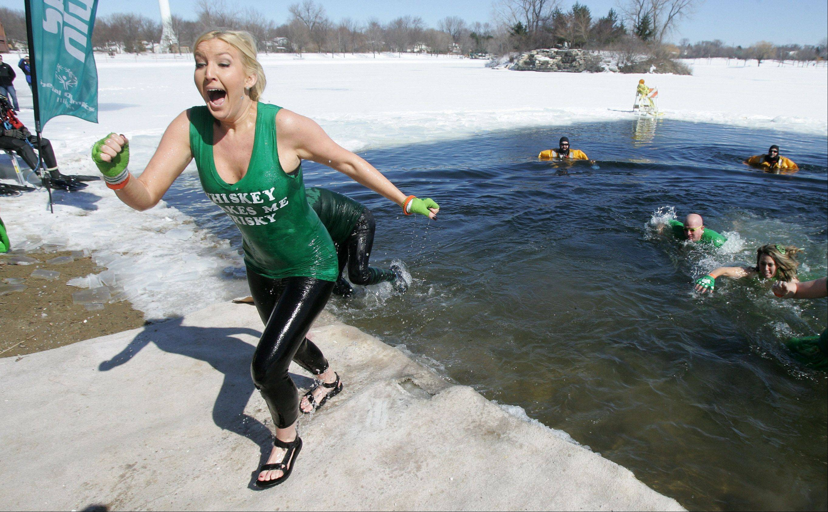 Lisa Musialowicz, with the Arlington Heights Police Department team called Ice Cold Cops, screams as she comes out of the frigid water during the 2013 Palatine Polar Plunge Sunday at Twin Lakes Recreation Area in Palatine. More then 290 people braved the cold to take the plunge in the event sponsored by the Law Enforcement Torch Run to benefit Special Olympics Illinois.