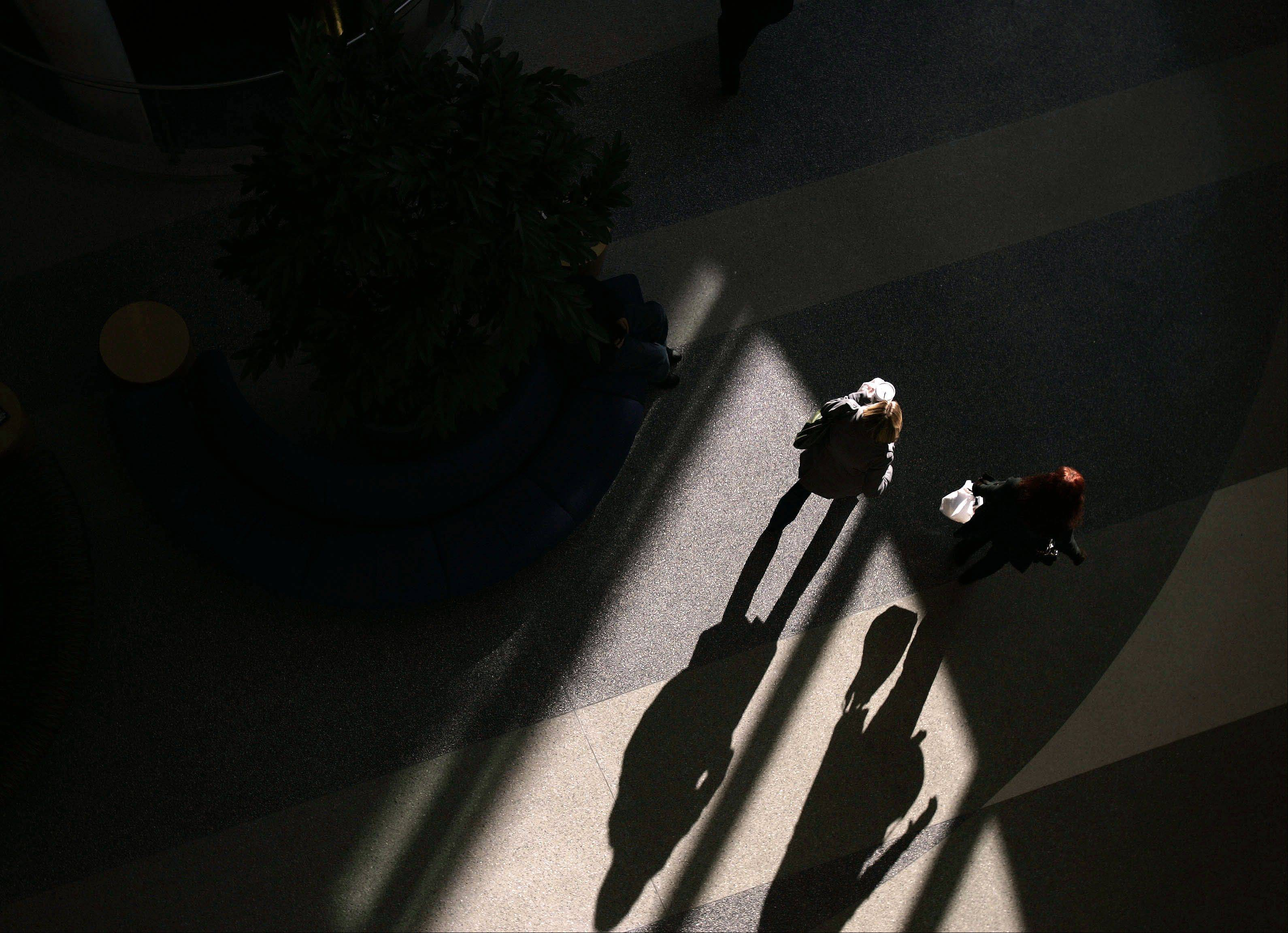 The play of light and the shadows can often change a normal scene into something altogether unrecognizable. I was at Sherman Hospital in Elgin recently on assignment when I went upstairs in the lobby to get a different angle and saw this scene below.