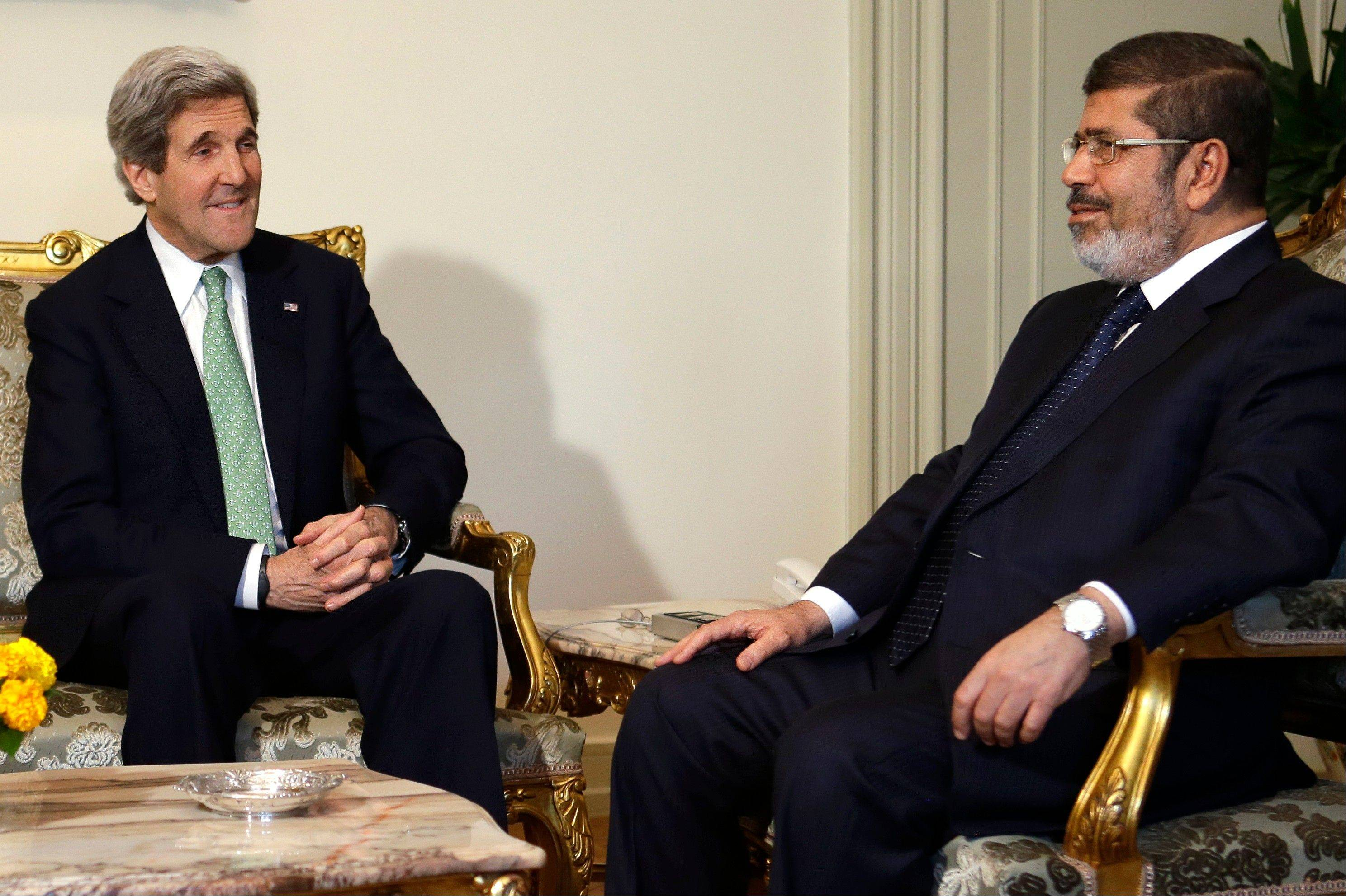 Secretary of State John Kerry, left, meets with Egyptian President Mohamed Morsi at the Presidential Palace in Cairo on Sunday.