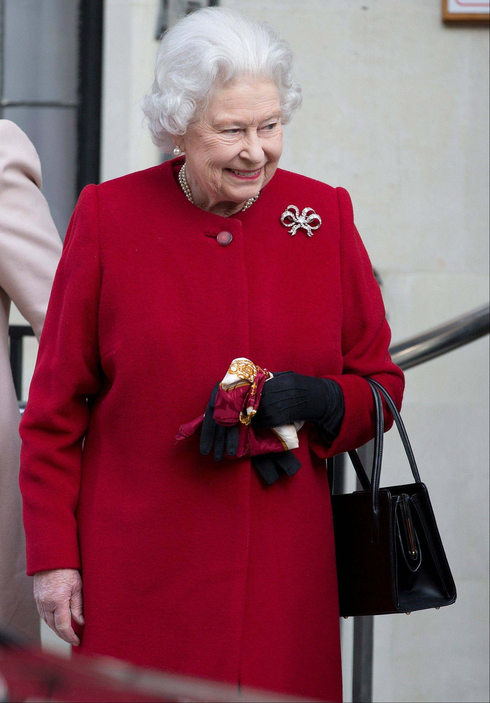 Britain's Queen Elizabeth II leaves the King Edward VII hospital following a one-day stay caused by a stomach ailment, London Monday, March 4, 2013. The 86-year-old queen fell ill Friday and was being treated at Windsor Castle until Sunday, when she was moved to a central London hospital as a precaution.