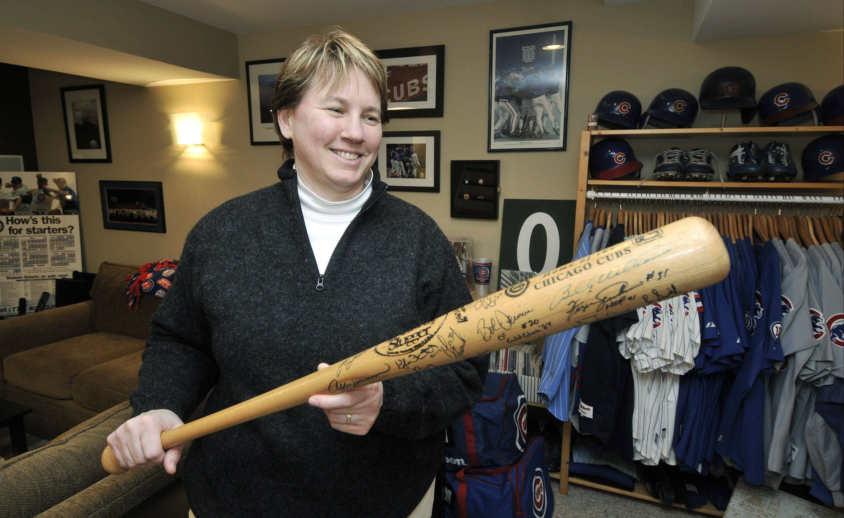 Starting with a bat featuring the autograph of legend Billy Williams, fan and collector Kelley Neal soon filled the bat with so many other signatures from her favorite Cubs players that she needed to buy a second bat.