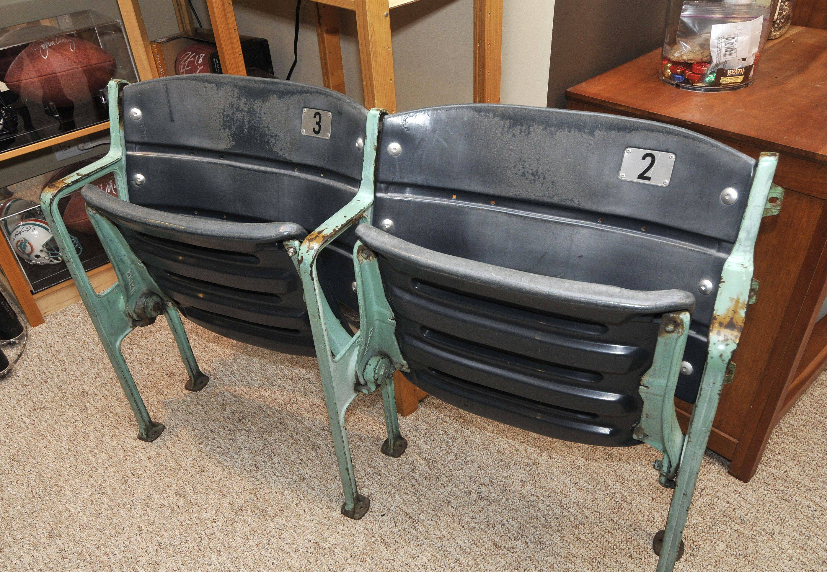 "Interesting souvenirs such as these old seats from Wrigley Field helped win Sue Kren and fellow collector Kelley Neal a spot on a new reality show called ""A Piece of the Game."""