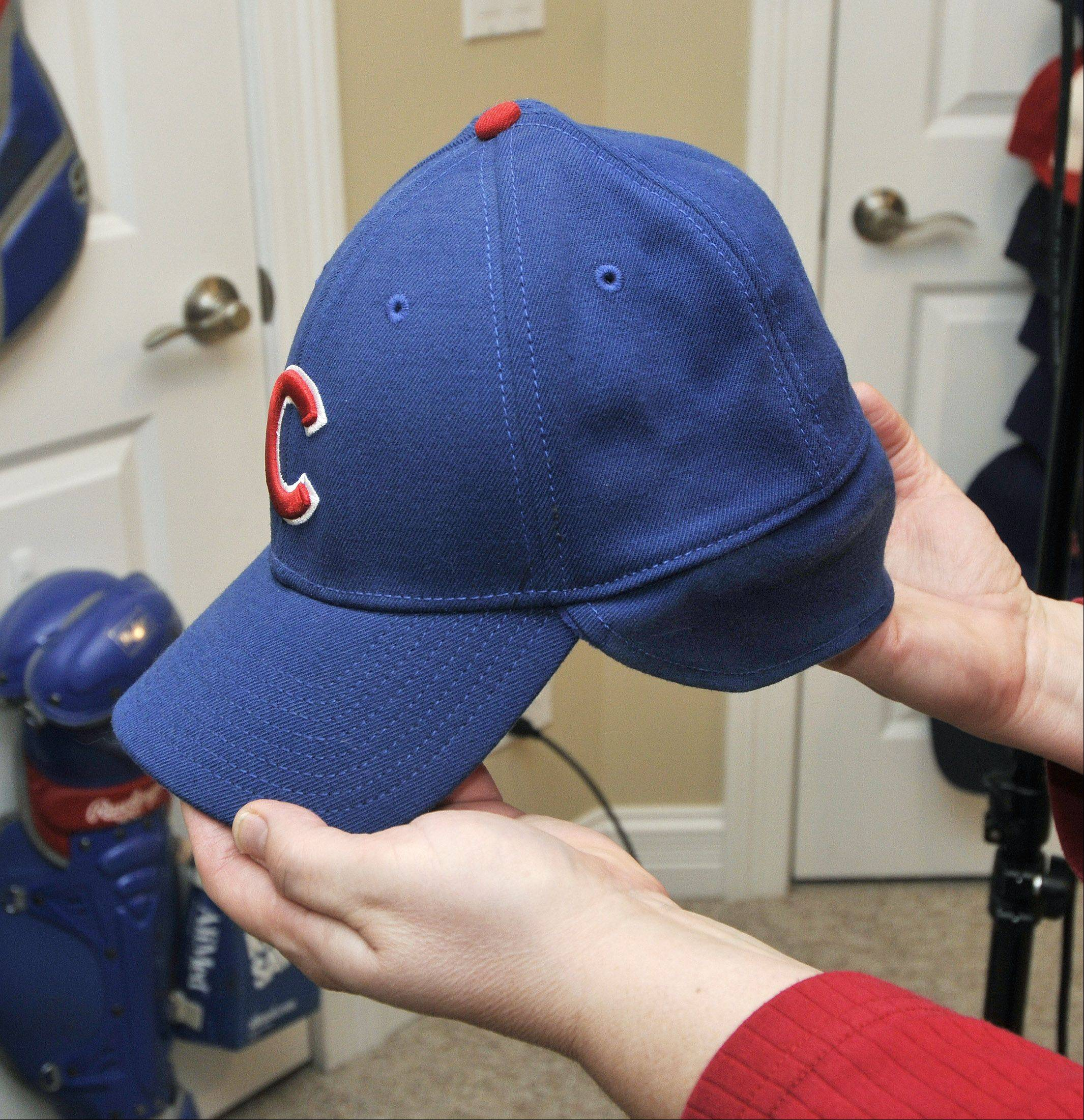 Chicago Cubs slugger Aramis Ramirez now plays for Milwaukee, but collector Sue Kren still has plenty of Ramirez souvenirs such as this hat with the added flaps for cold-weather games.