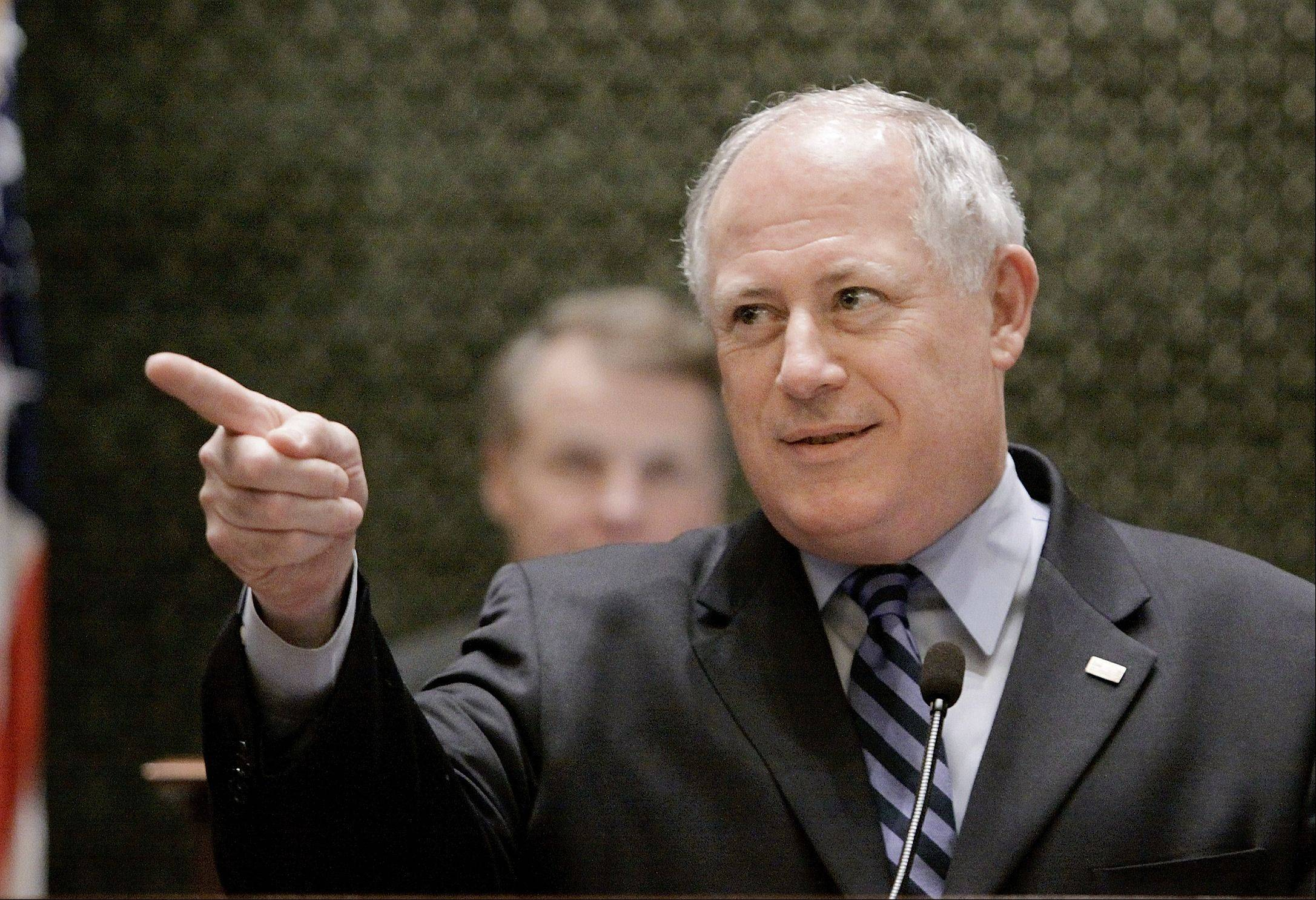 Illinois Gov. Pat Quinn delivers his State of the Budget Address to a joint session of the General Assembly on the House floor at the Illinois State Capitol in Springfield, Ill., Wednesday, March 18, 2009. (AP Photo/Seth Perlman)