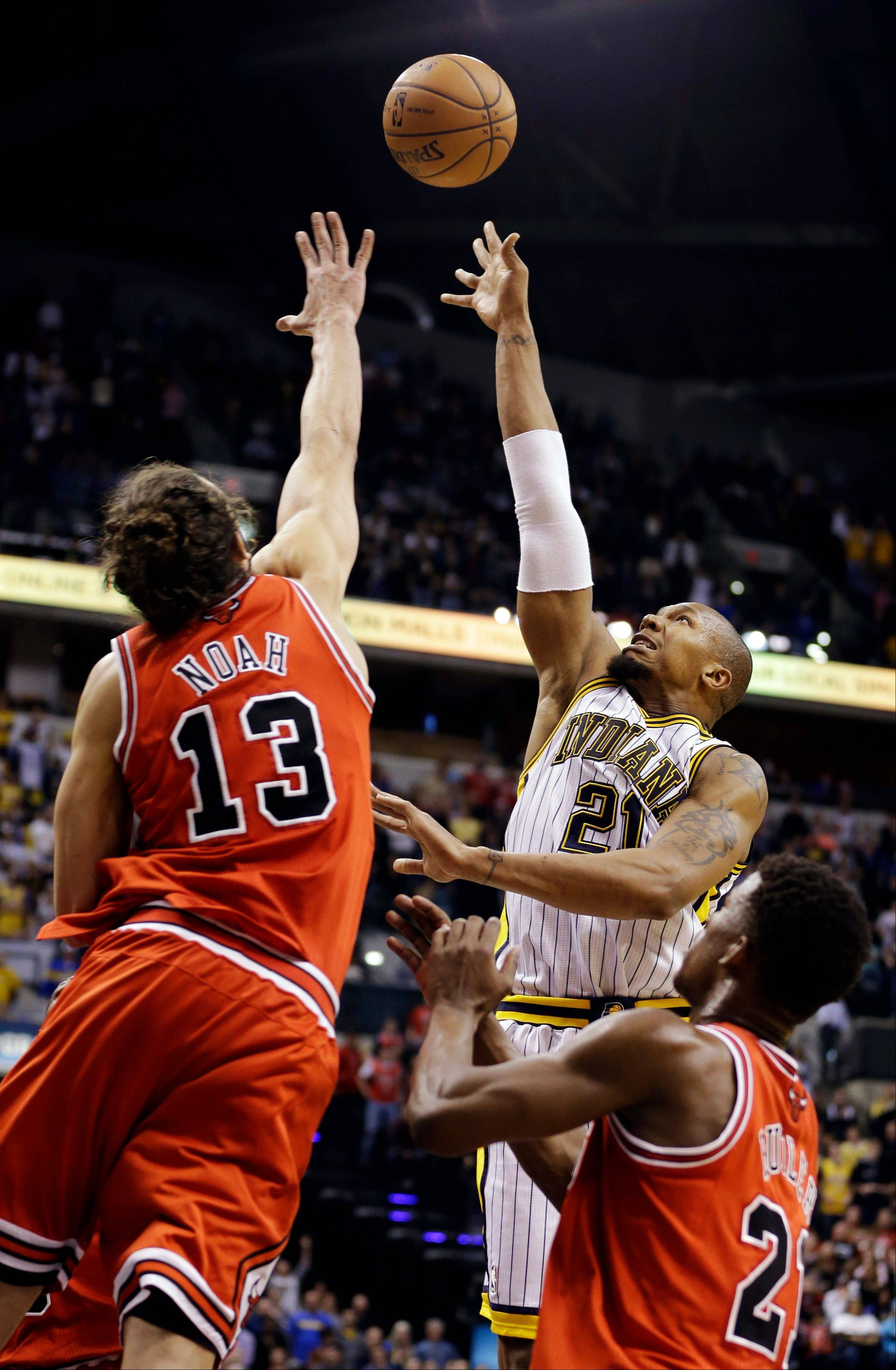 Indiana Pacers' David West (21) shoots against Chicago Bulls' Joakim Noah (13) and Jimmy Butler during the second half of an NBA basketball game, Sunday, March 3, 2013, in Indianapolis. Indiana won 97-92.