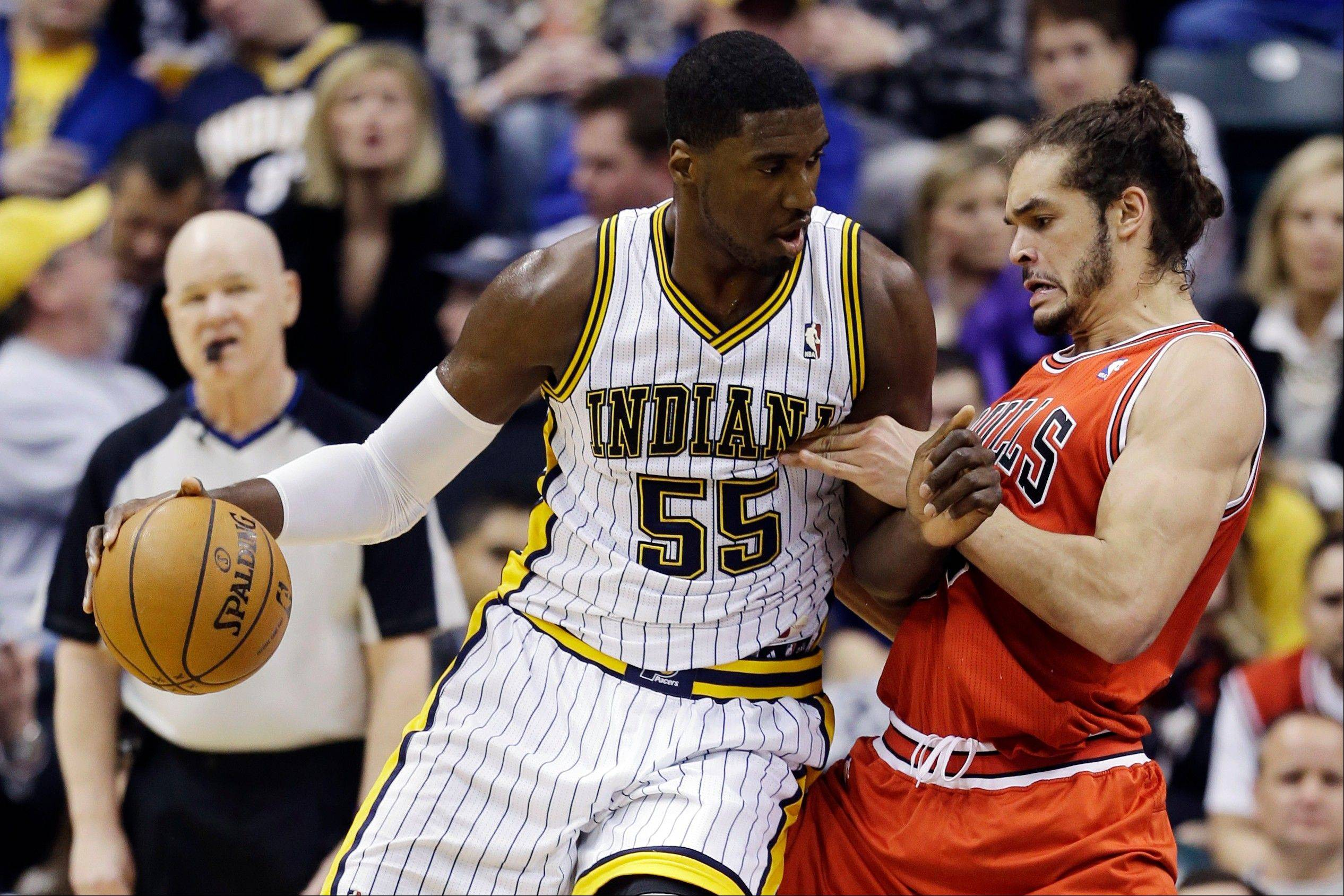 The Indiana Pacers' Roy Hibbert pushes back Bulls center Joakim Noah during Sunday's first half.