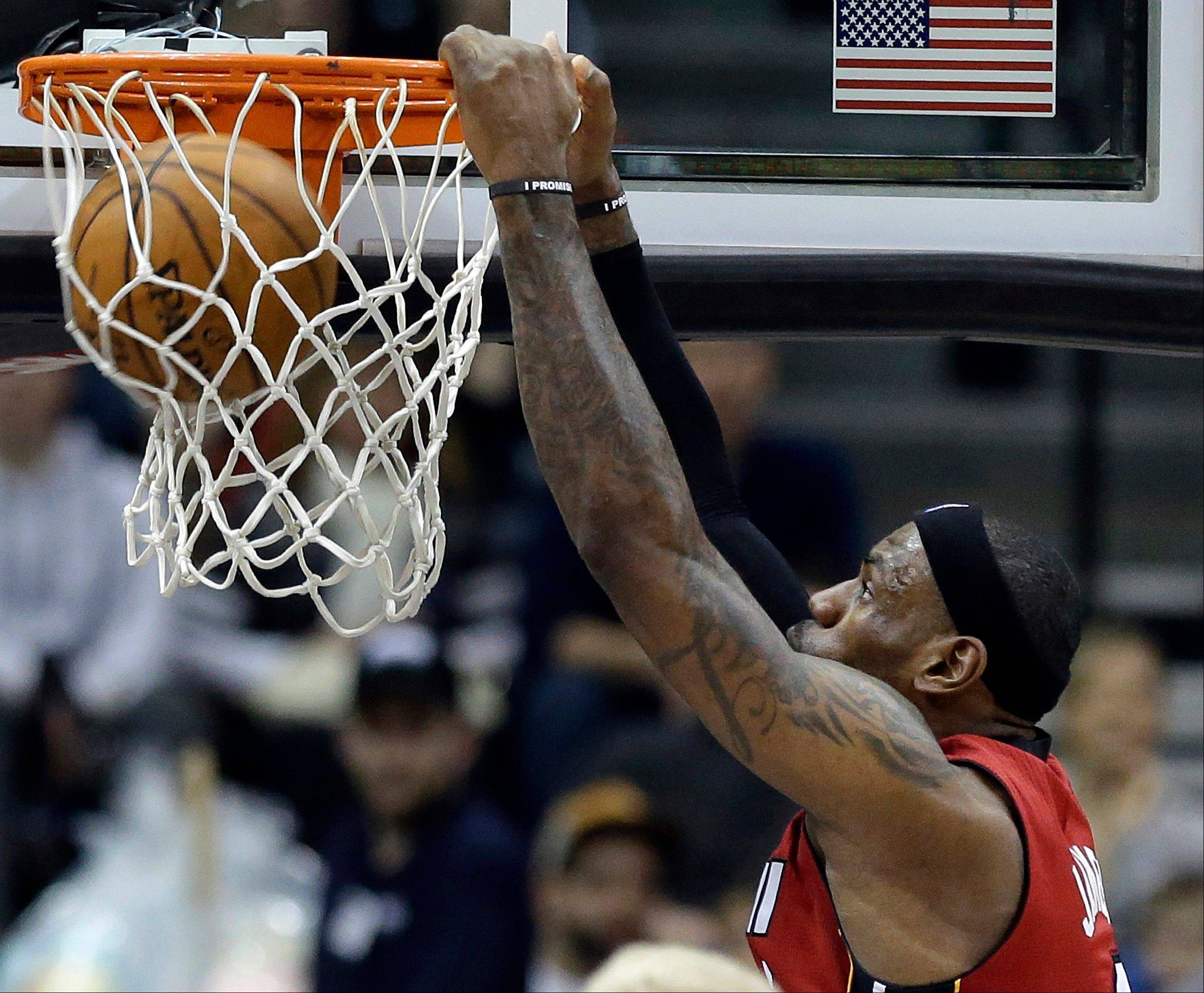 Miami Heat�s LeBron James dunks in the first half of an NBA basketball game against the Minnesota Timberwolves Monday, March 4, 2013, in Minneapolis.