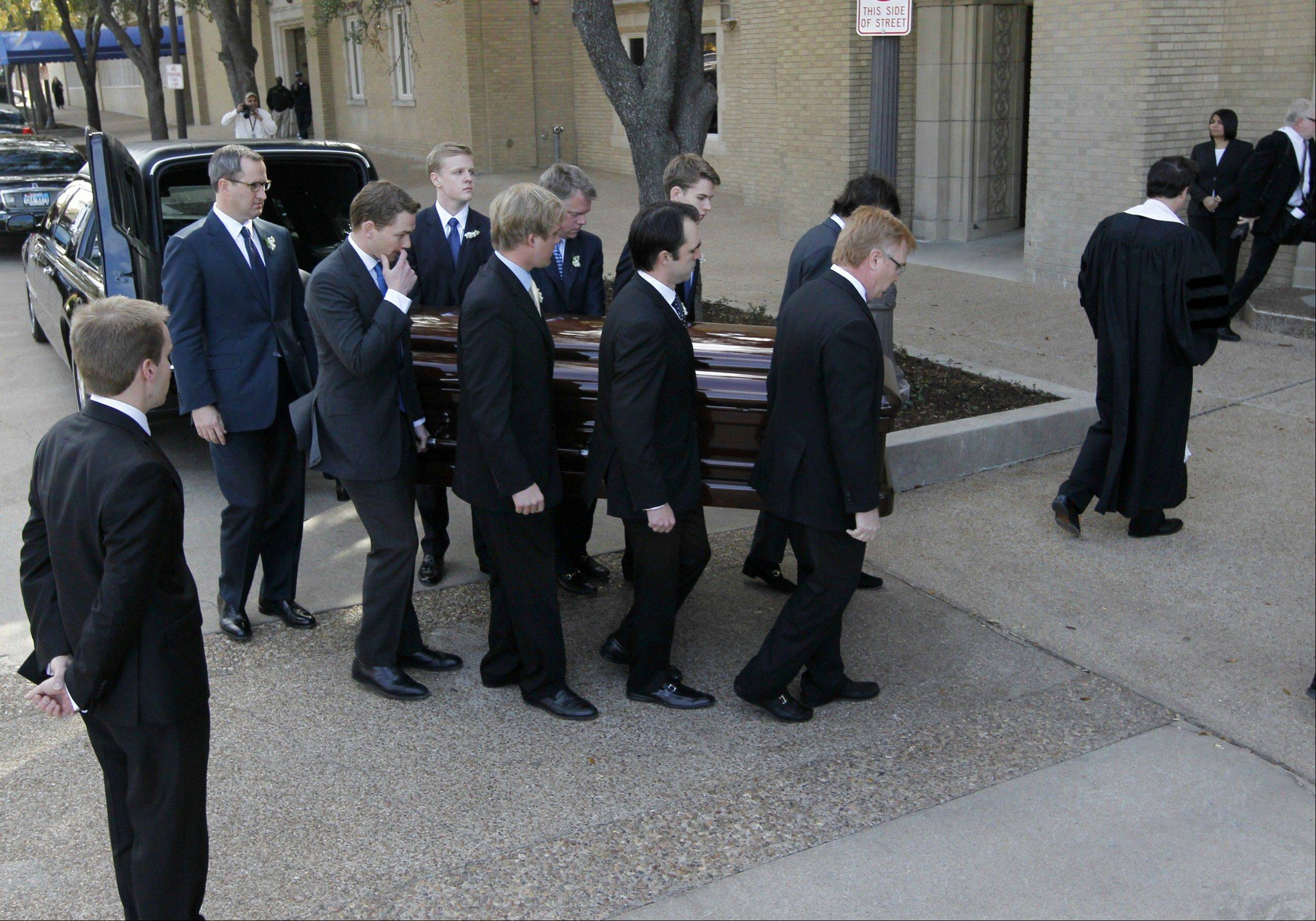Pallbearers carry Van Cliburn's coffin into Broadway Baptist Church for a funeral service in Fort Worth, Texas on Sunday.
