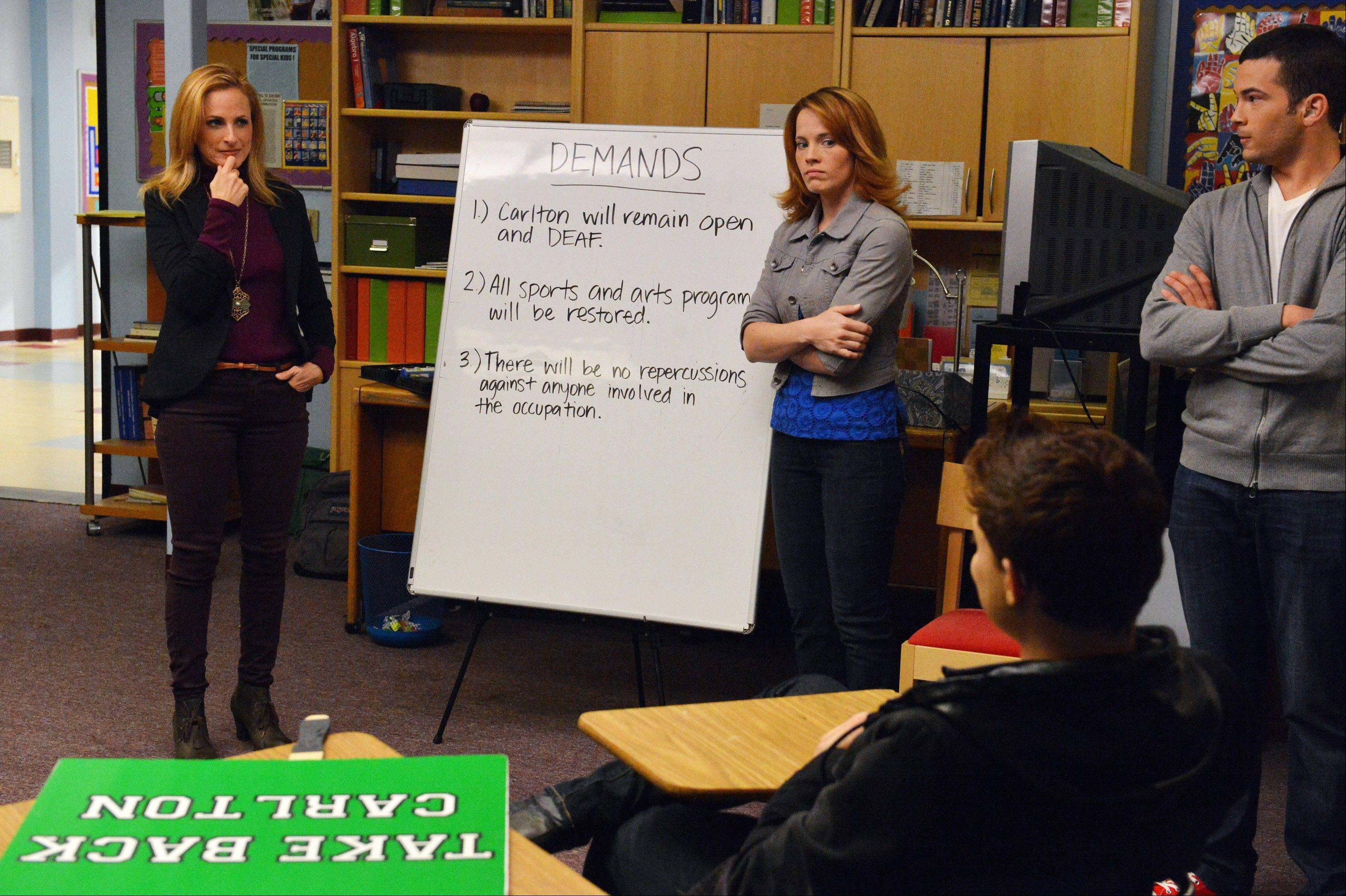 "Marlee Matlin, left, Katie Leclerc and Brian Gutierrez participate in a mostly silent episode of ""Switched at Birth"" to be aired Monday."