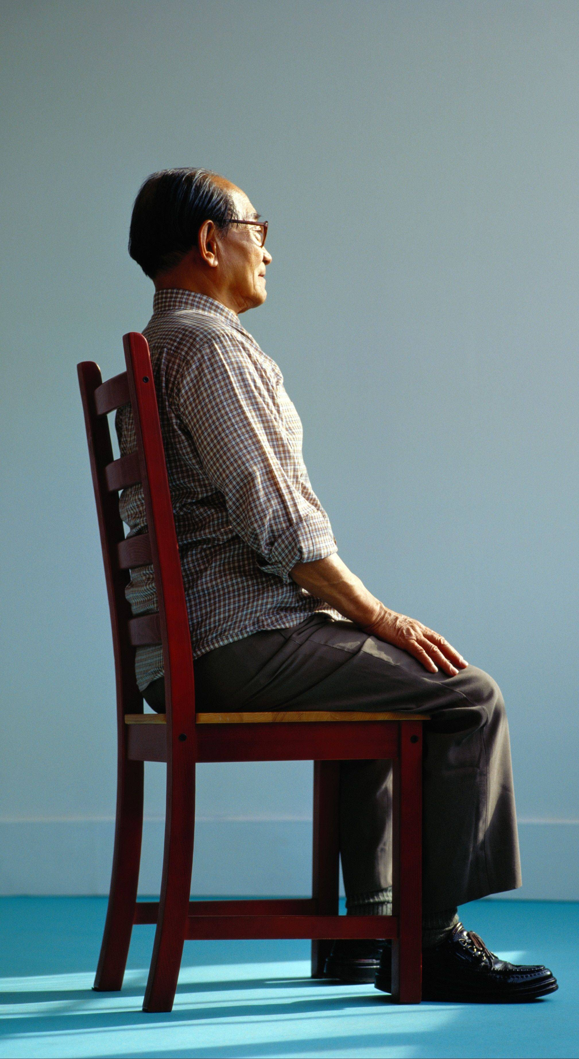 Doing simple exercises while sitting in a chair can help improve your posture and fend off back pain.
