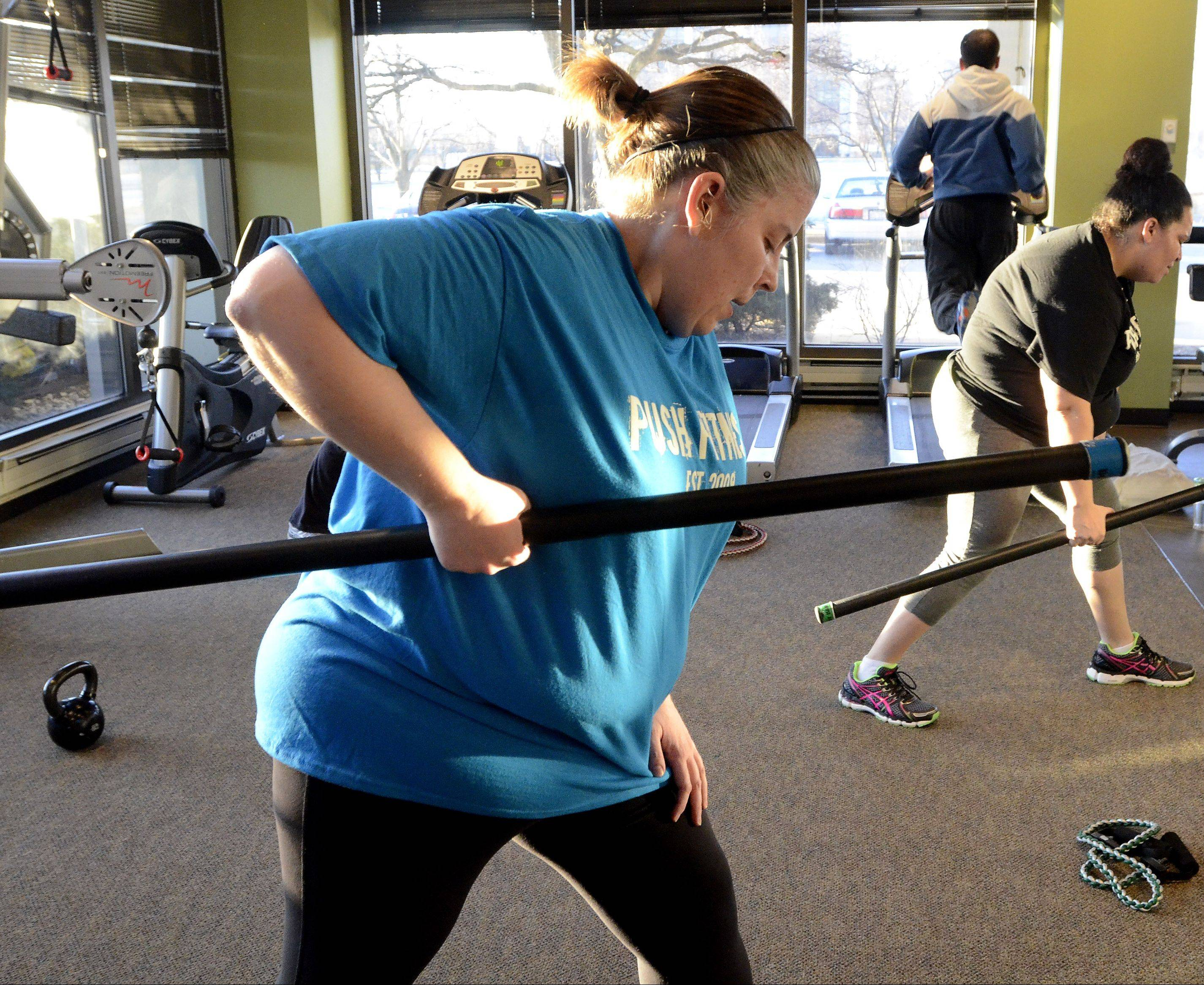 That's me, working out with a weighted bar during the Fittest Loser boot camp at Push Fitness.