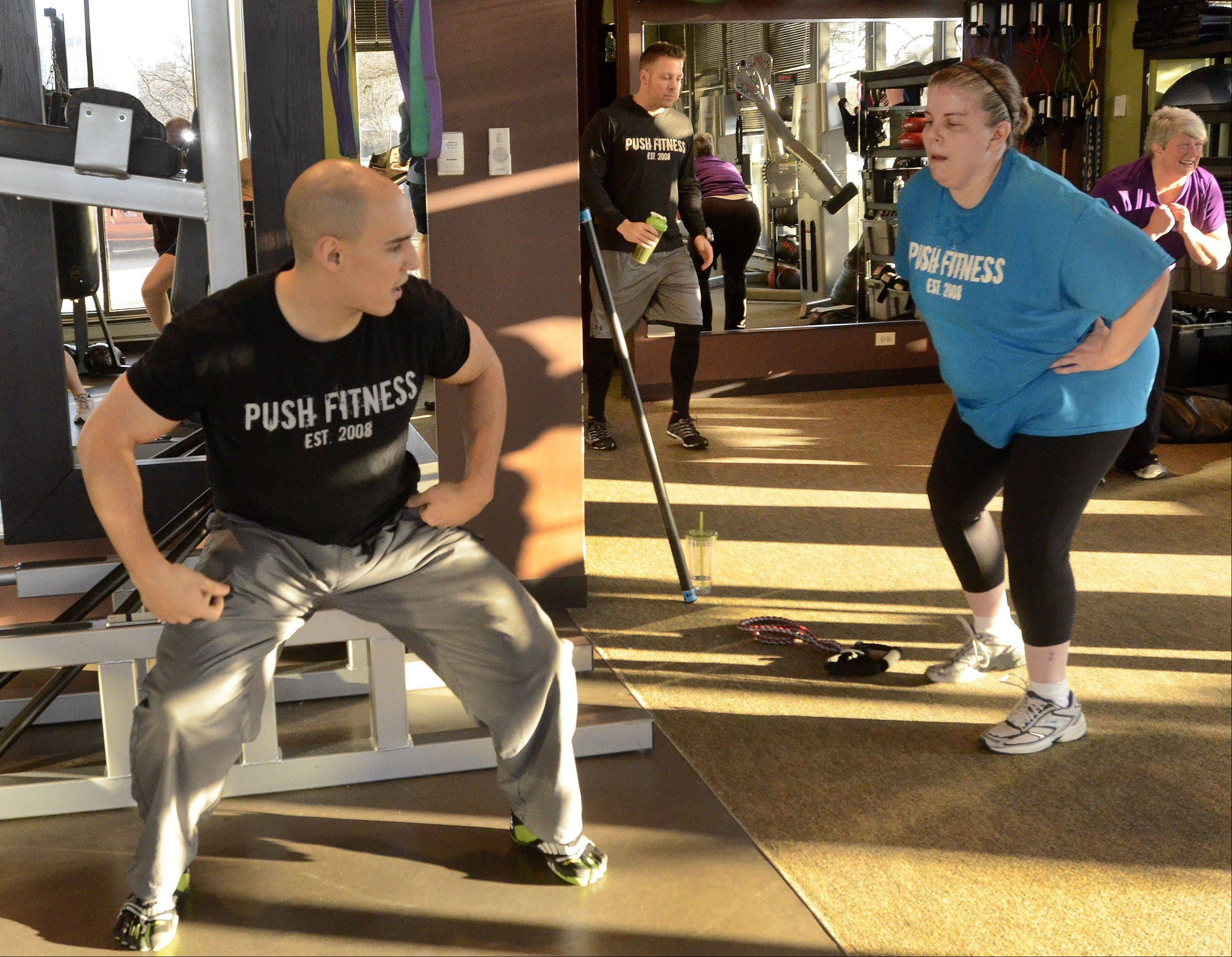"Trainer Tony Rinehart offers some suggestions during a Fittest Loser boot camp on a recent Saturday morning at Push Fitness in Schaumburg. I have no idea what he was telling me, because my brain was only thinking ""I survived eight flights of stairs! I can do anything!"""