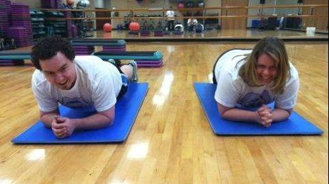 Eric Lawhead, left, and Erin Chapa of Addison's Club Fit Five test their strength by holding a plank.