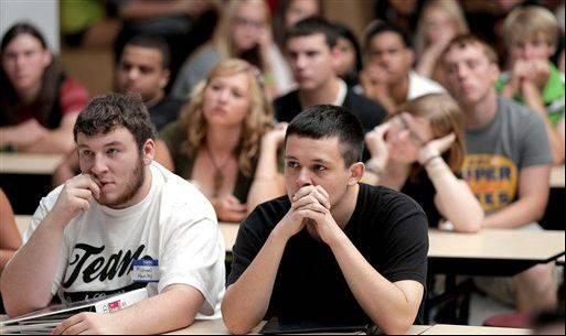 Students listen during an assembly on the first day of school at a temporary high school in a converted store in Joplin, Mo., nearly three months after an EF-5 tornado destroyed six schools and damaged four others along with killing 160 people and devastating a third of the city.