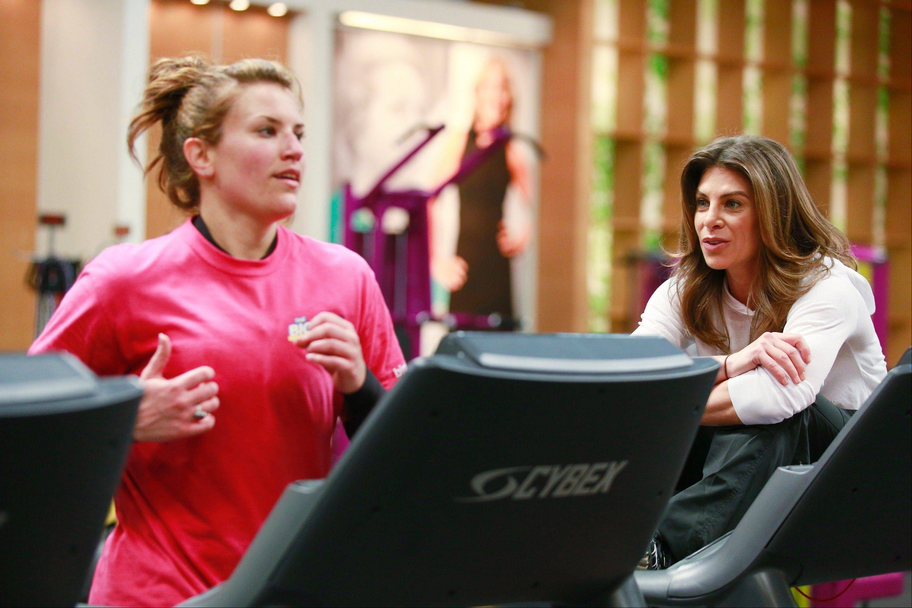 "Wheeling's Danni Allen works out on the treadmill as her trainer, Jillian Michaels, helps keep her motivated on NBC's ""The Biggest Loser."""