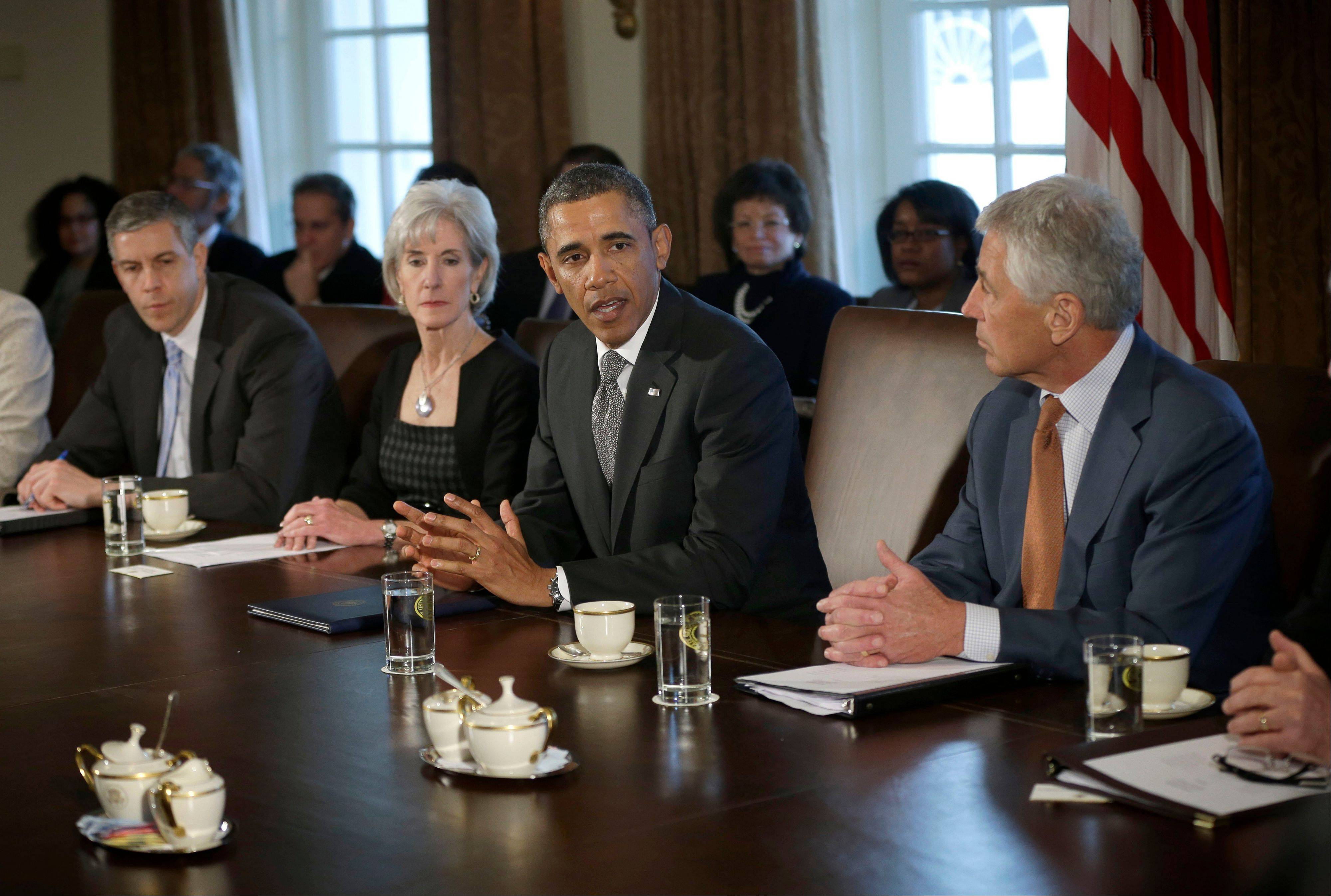 President Barack Obama speaks to members of the media at the start of a Cabinet meeting at the White House Monday. From left are, Education Secretary Arne Duncan, Health and Human Services Secretary Kathleen Sebelius, the president and Defense Secretary Chuck Hagel.