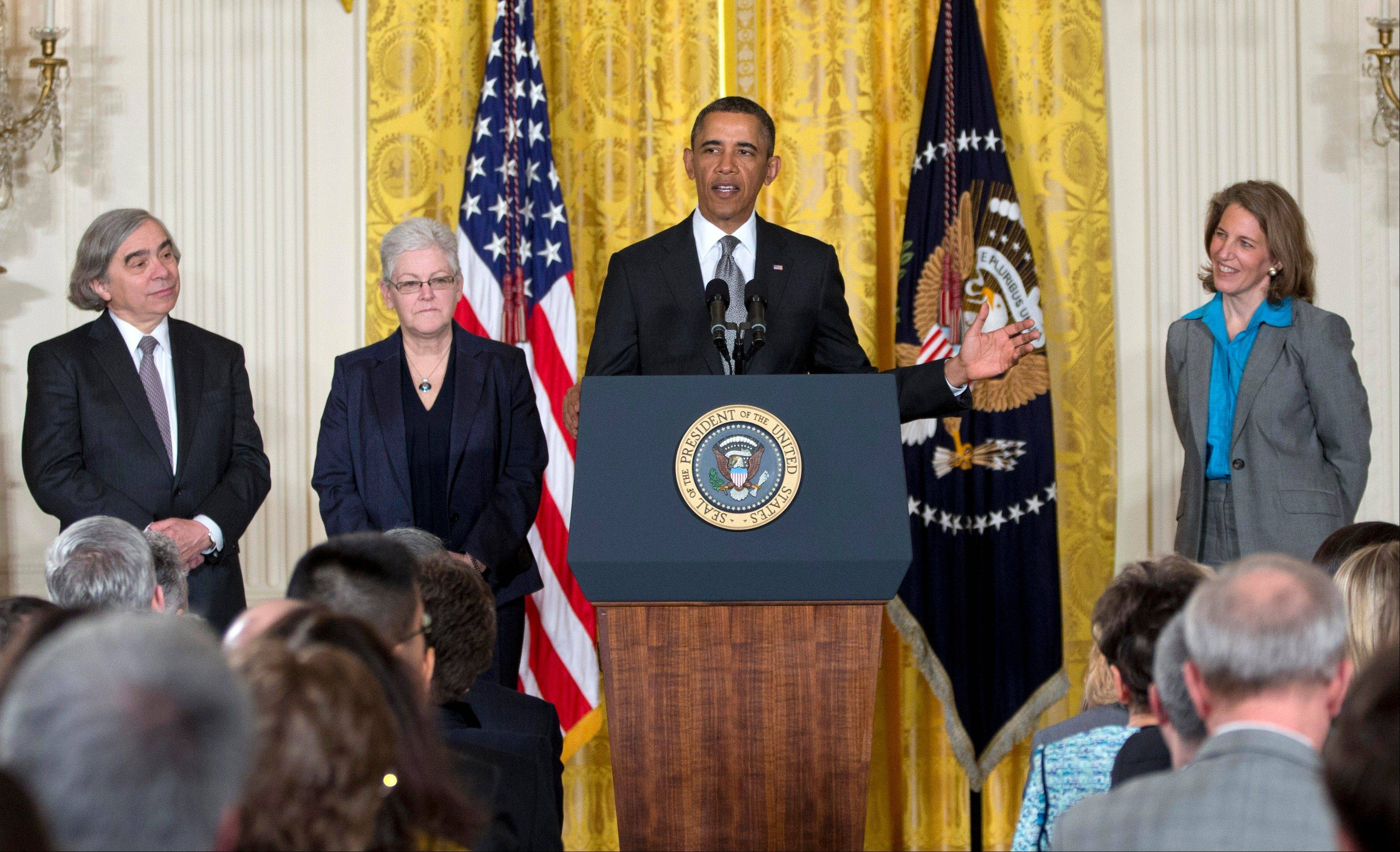 President Barack Obama announces at the White House Monday he will nominate, from left, MIT physics professor Ernest Moniz for Energy secretary, Gina McCarthy to head the EPA; and Walmart Foundation President Sylvia Mathews Burwell to head the Budget Office.