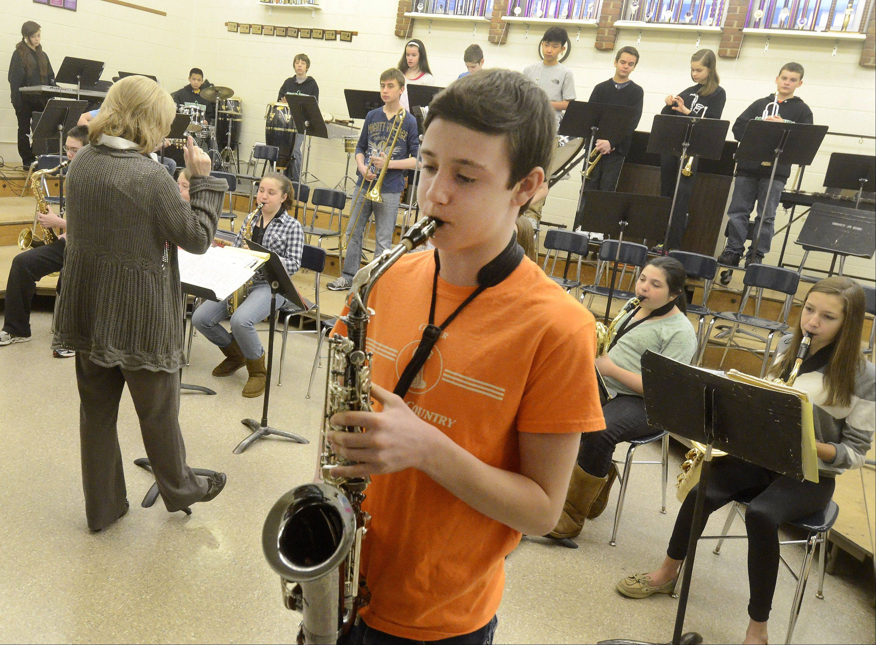 Anthony Sorgani plays an alto sax solo, as the Cooper School jazz band practices for the next competition.