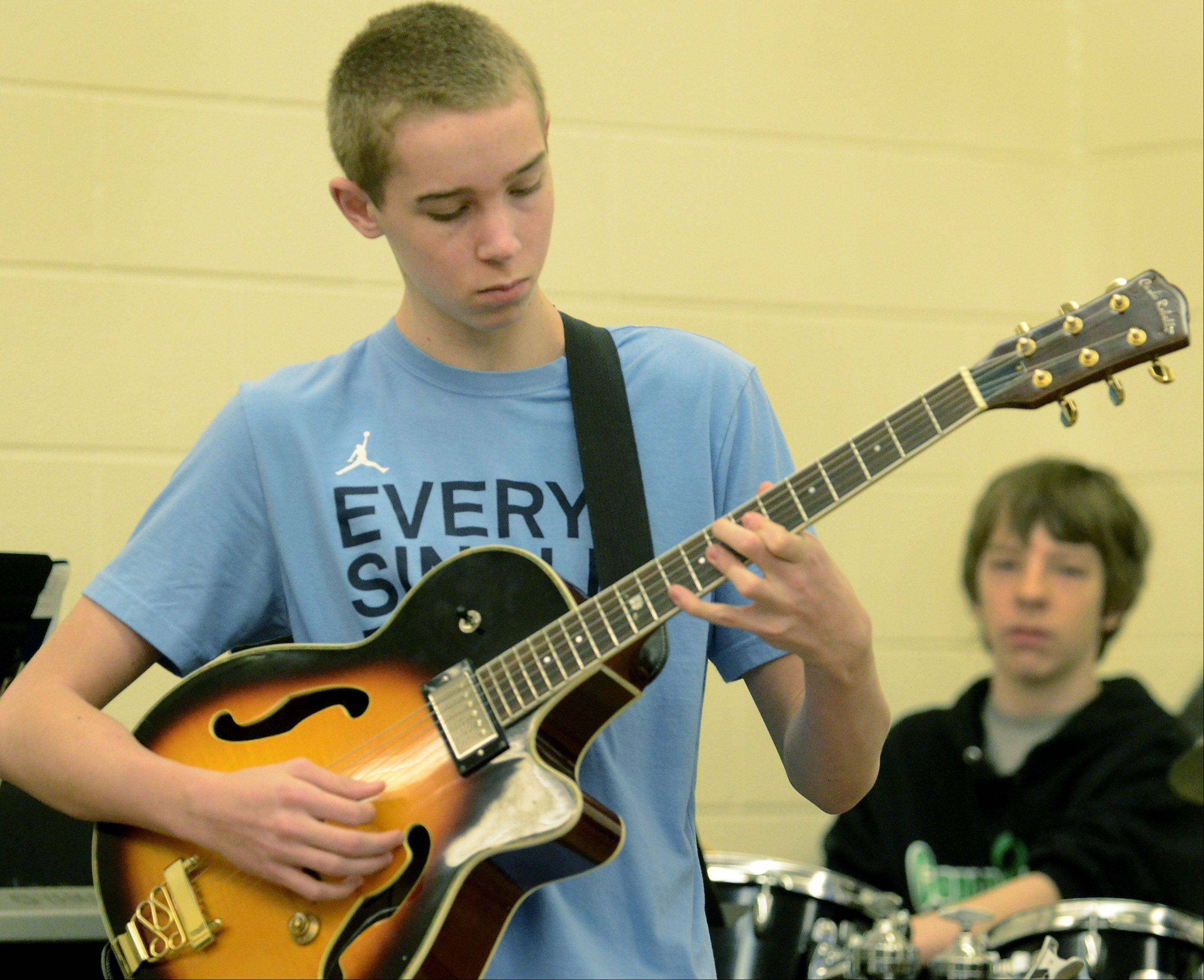 Jack Merrill plays a guitar solo while the Cooper School jazz band practices for the next competition.