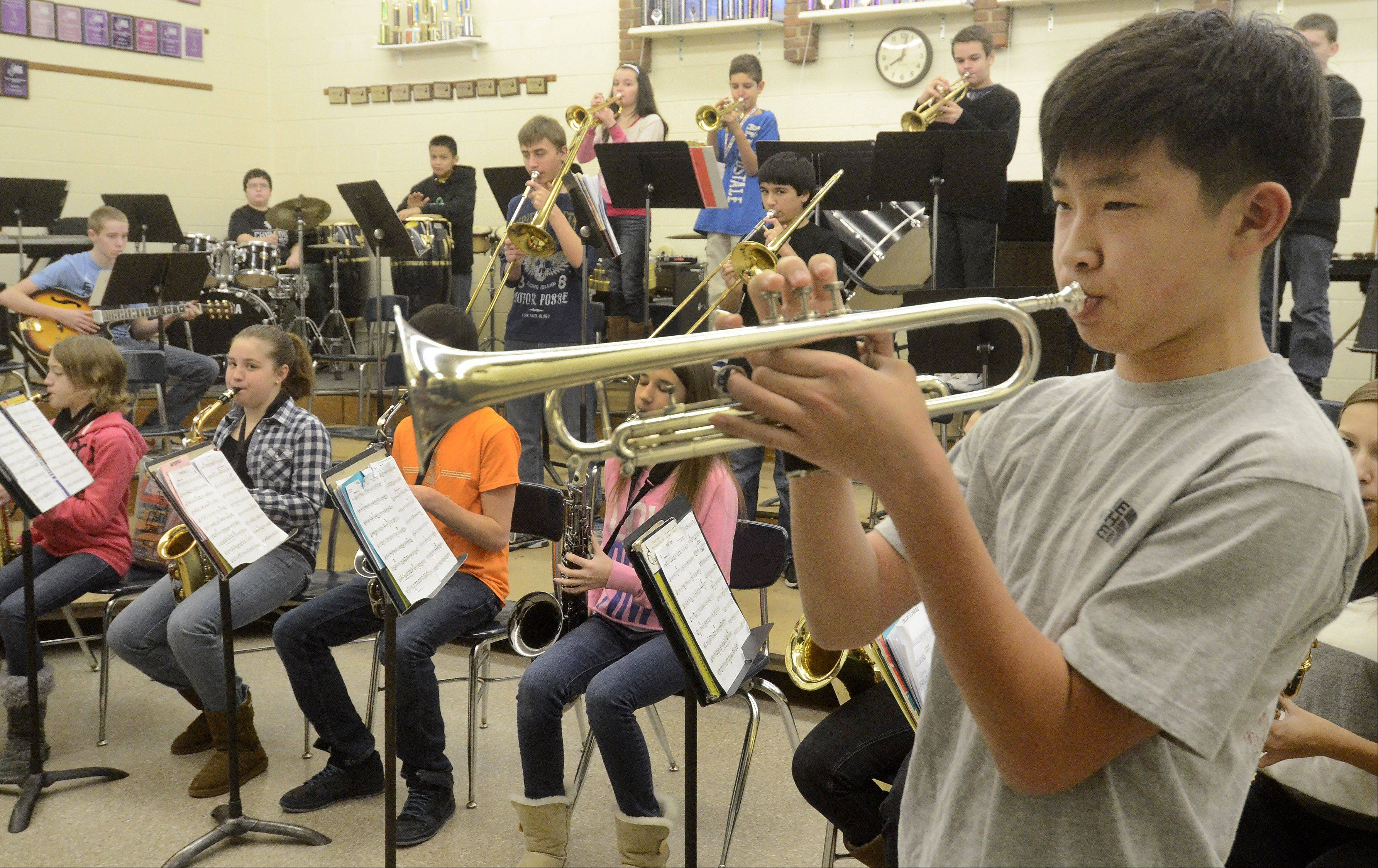 Harrison Park plays a trumpet solo, while the Cooper School jazz band practices for the next competition.