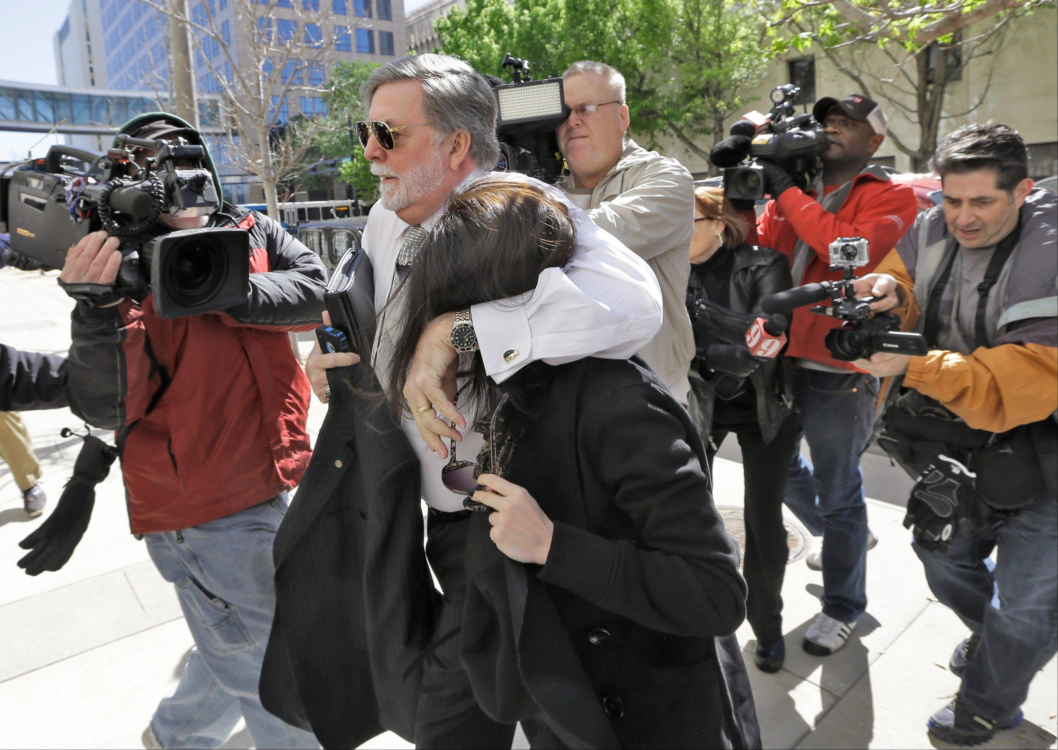 Casey Anthony is protected from the media by her attorney Cheney Mason as she arrives at the United States Courthouse for a bankruptcy hearing Monday in Tampa, Fla. Anthony has not been seen in public since being acquitted in 2011 of murdering her two-year-old daughter Caylee.