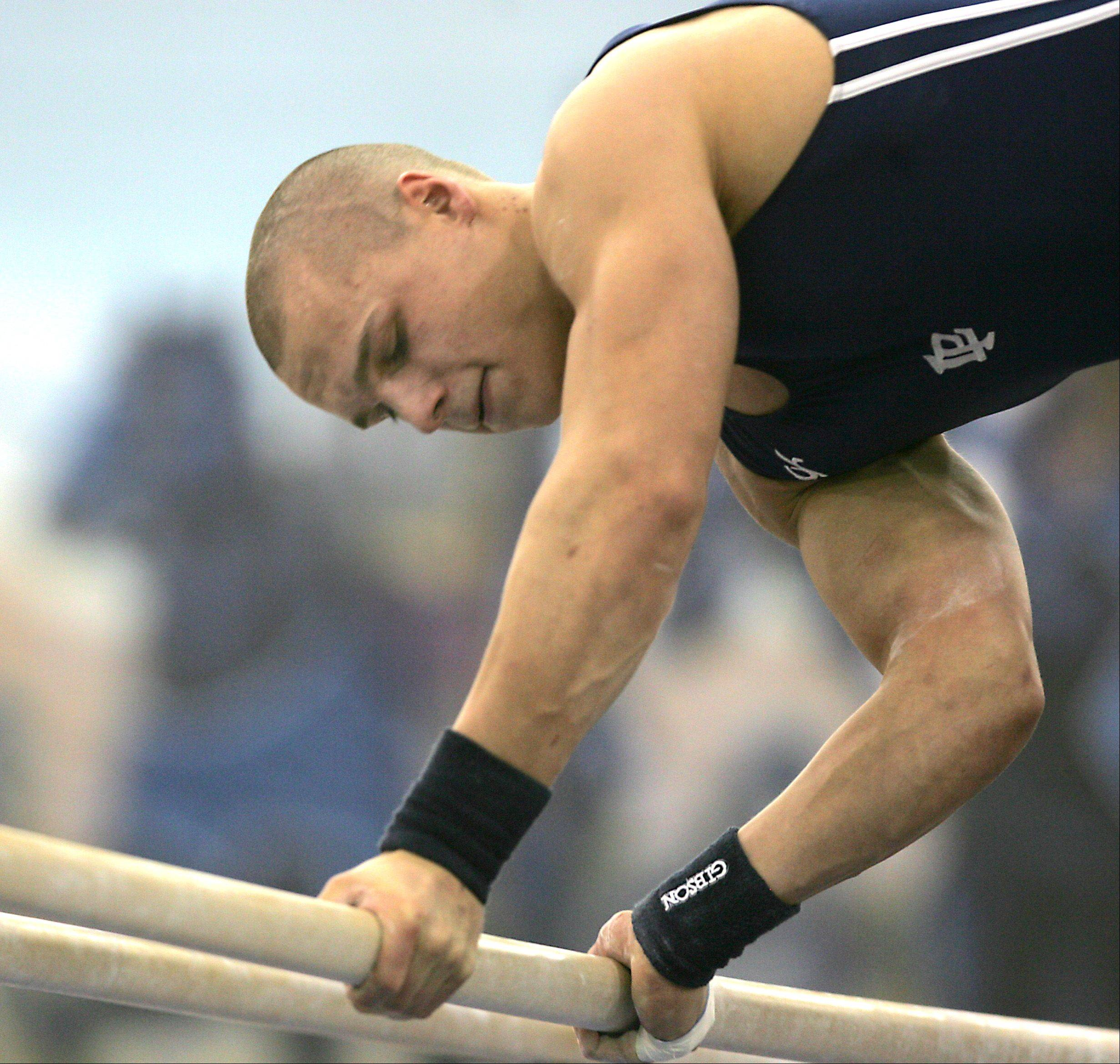 Lake Park's Mac Allen dismounts from his parallel bar routine, during the Ralph Krupke Boys Gymnastics Invitational at Lake Park East High School.